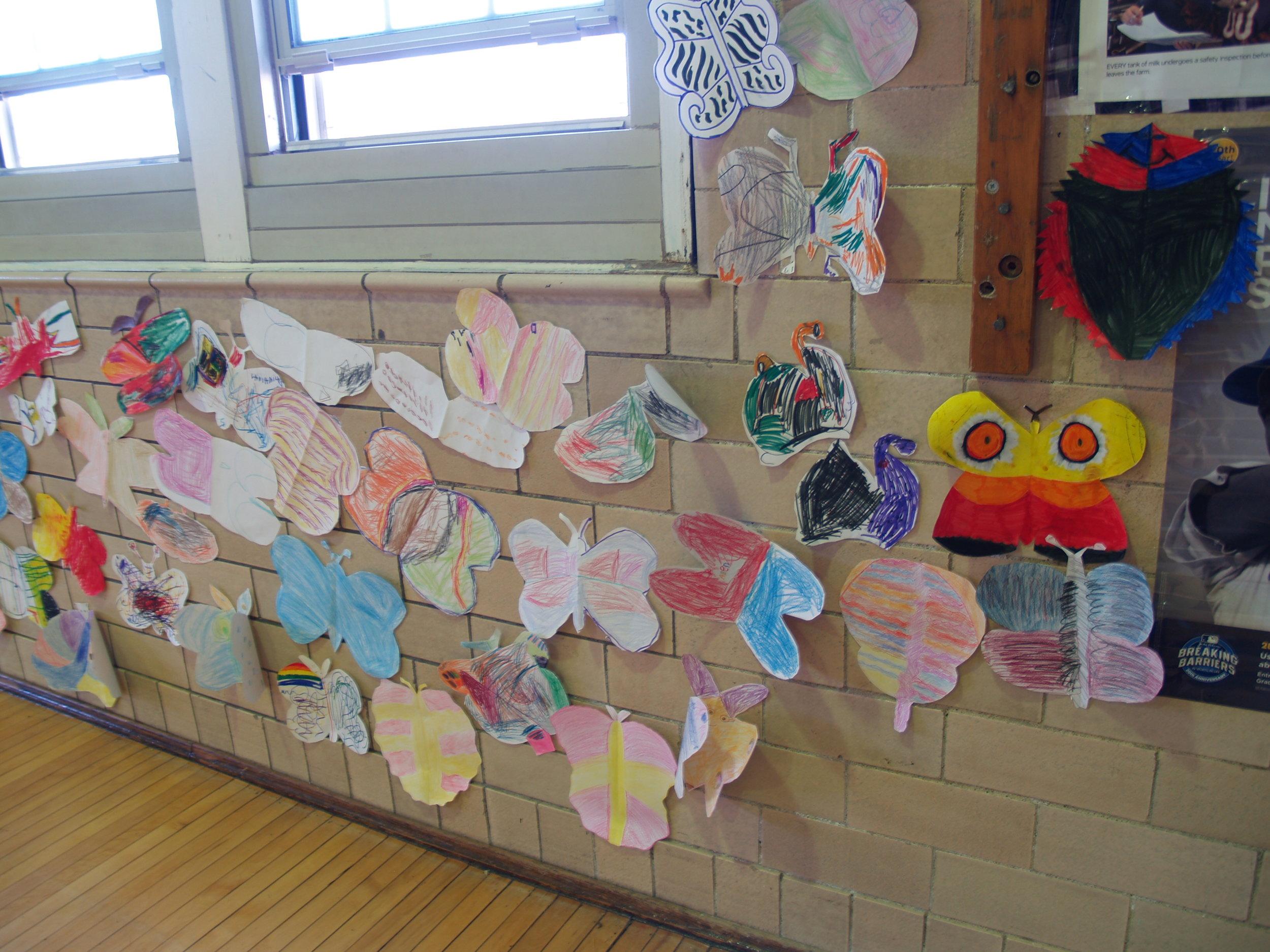 Longfellow kindergarteners and and 6th graders' moth drawings.