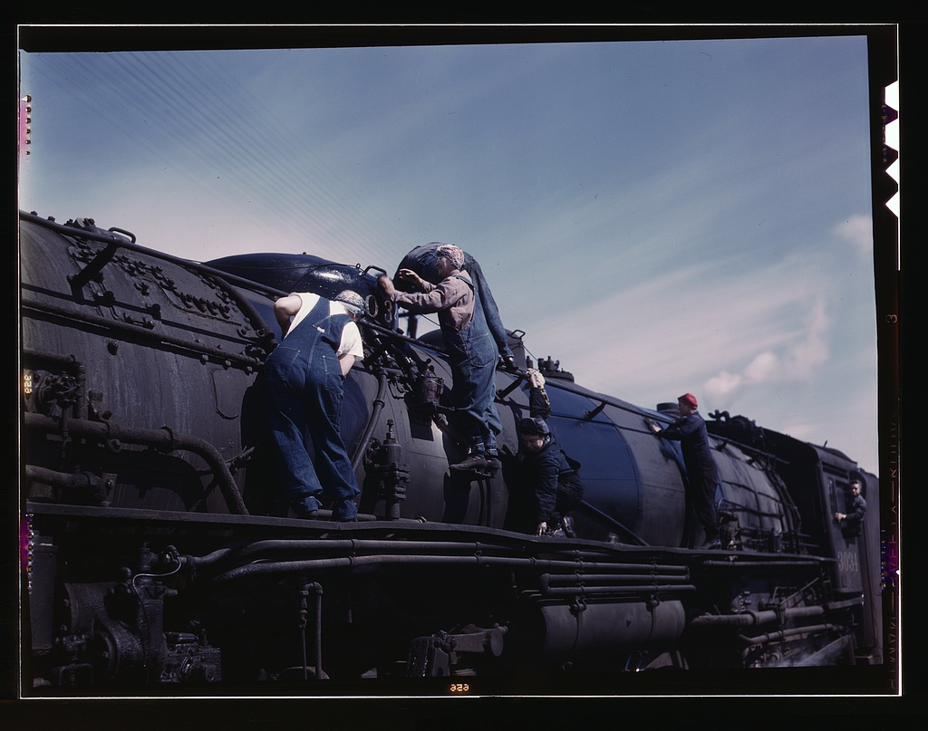 "Chicago & North Western R.R., women wipers employed at the roundhouse cleaning one of the giant ""H"" class locomotives.   Source"