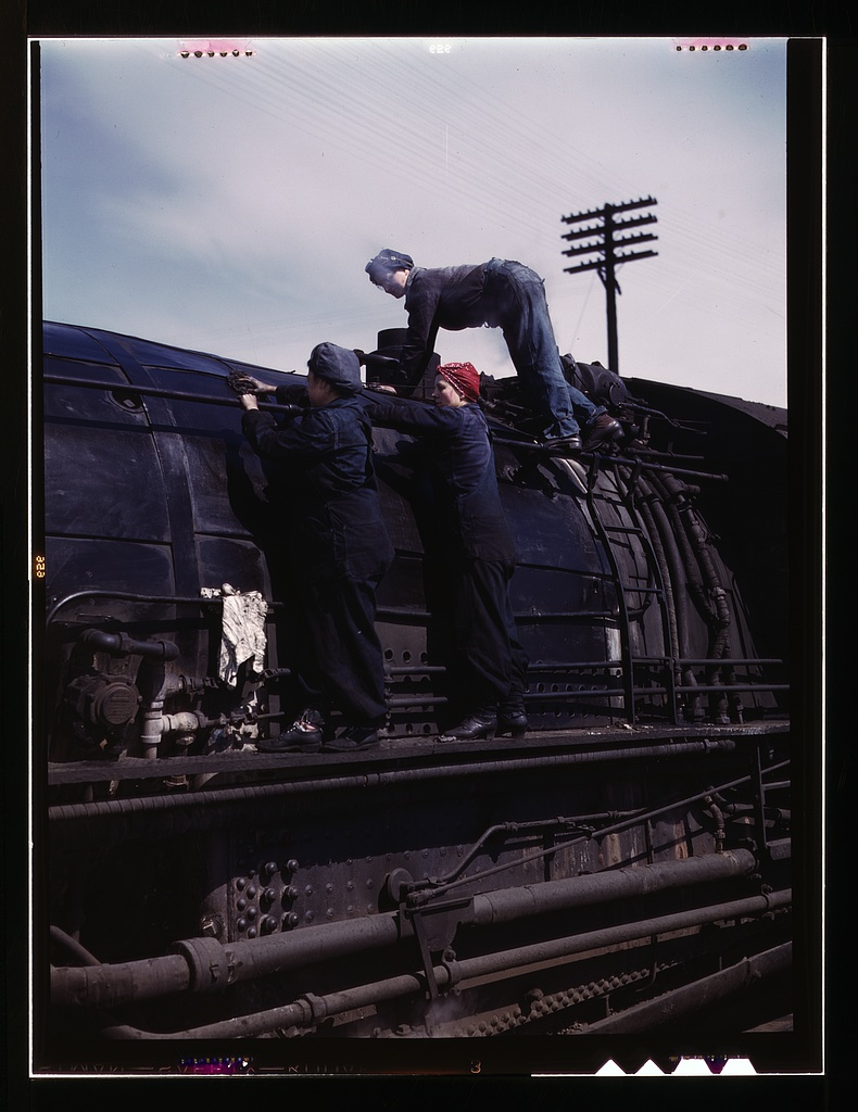 "Chicago & North Western R.R., women wipers at the roundhouse cleaning one of the giant ""H' class locomotives.   Source"