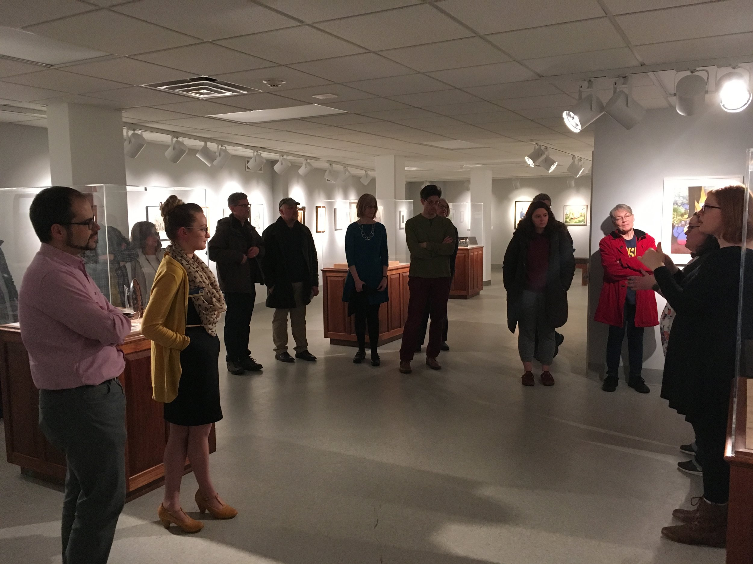 Charles Haag's Art + Archive at Augustana. Tour led by Dr. Kimberly La Palm (Scandinavian Studies) and Lisa Huntsha (Swenson Swedish Immigration Research Center). ASL interpreter: Bambi Suits.