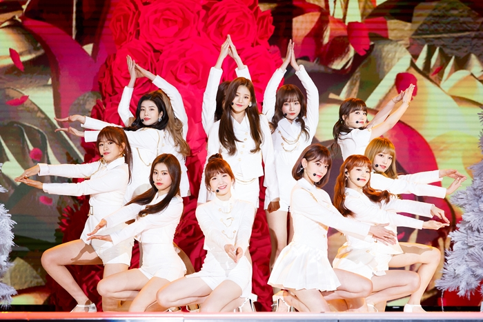 The new Korean-Japanese girl band IZ*ONE on Dec. 17 performs on stage during the 2018 Mnet Asian Music Awards (MAMA) Premier in Korea at Dongdaemun Design Plaza (DDP) in Seoul.