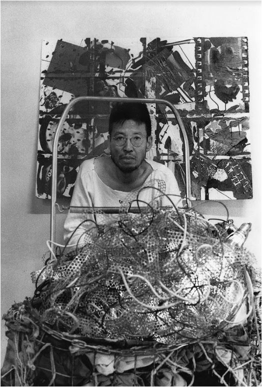 Chan S. Chung with his artworks at his Greenpoint studio, 1985, Photo by Lim Young Kyun