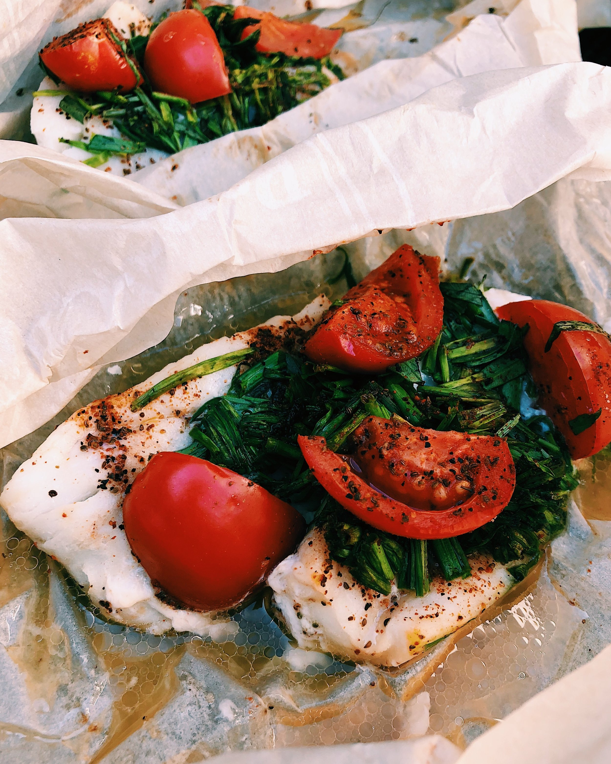 HERBED COD EN PAPPILLOTE - INGREDIENTS2, 4 oz cod filets1/3 cup chopped chives1/4 cup chopped tarragon1/2 cup chopped cherry tomatoes3 tb Brummel & Brown organic buttery yogurt spreadSalt & pepper to tasteTwo large pieces parchment paper, to wrap fish