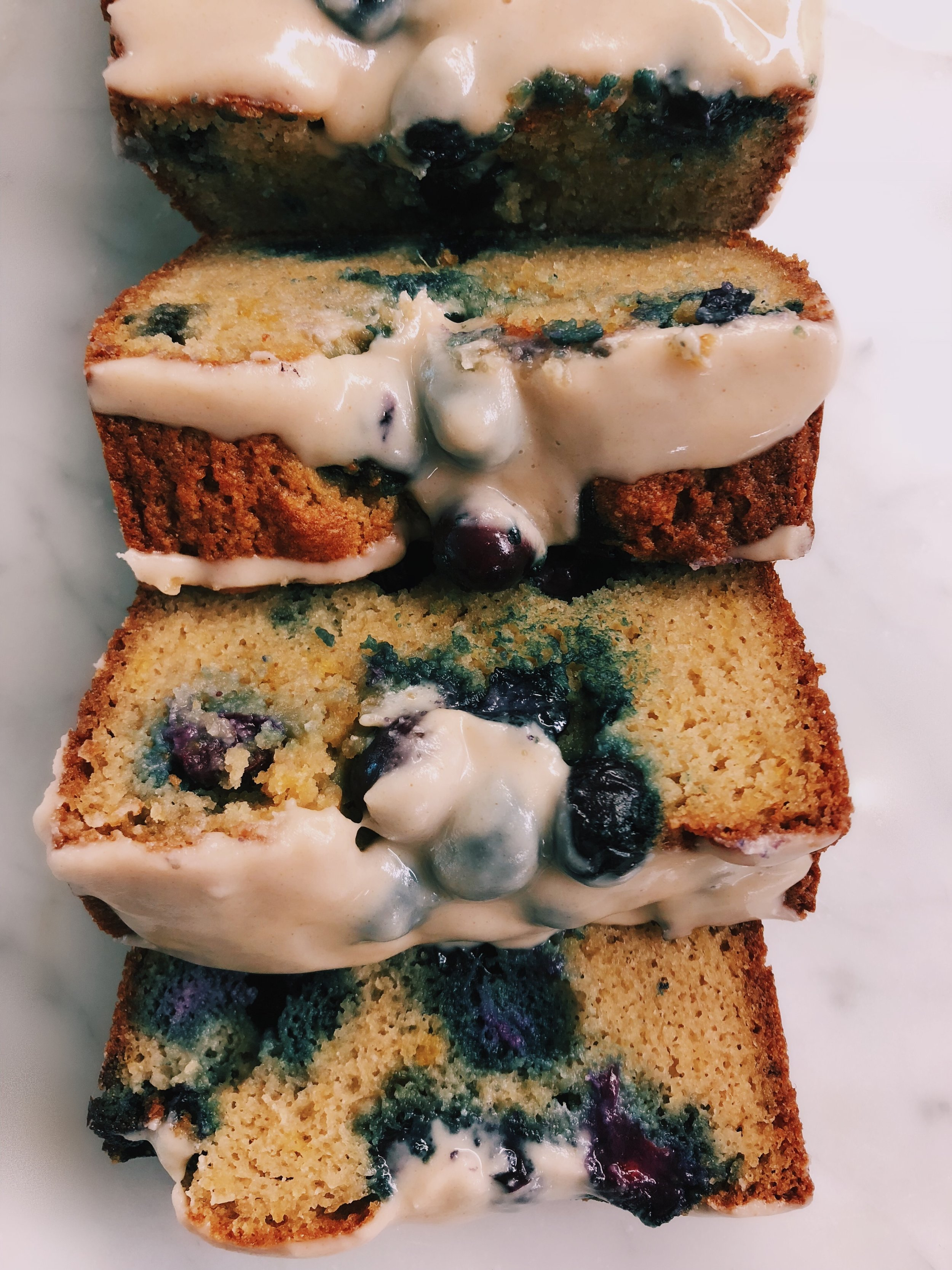 PALEO LEMON BLUEBERRY POUND CAKE - INGREDIENTS1 1/3 cup blanched almond flour (make sure to use FINE almond flour)1/3 cup coconut flour2 tb arrowroot powder1 1/2 tsp baking soda1 tsp cinnamon1/2 tsp salt3 eggsjuice from 2 lemonszest from the same 2 lemons!1/3 cup maple syrup1 cup fresh blueberriesTHE GLAZE:3 tb melted coconut butter