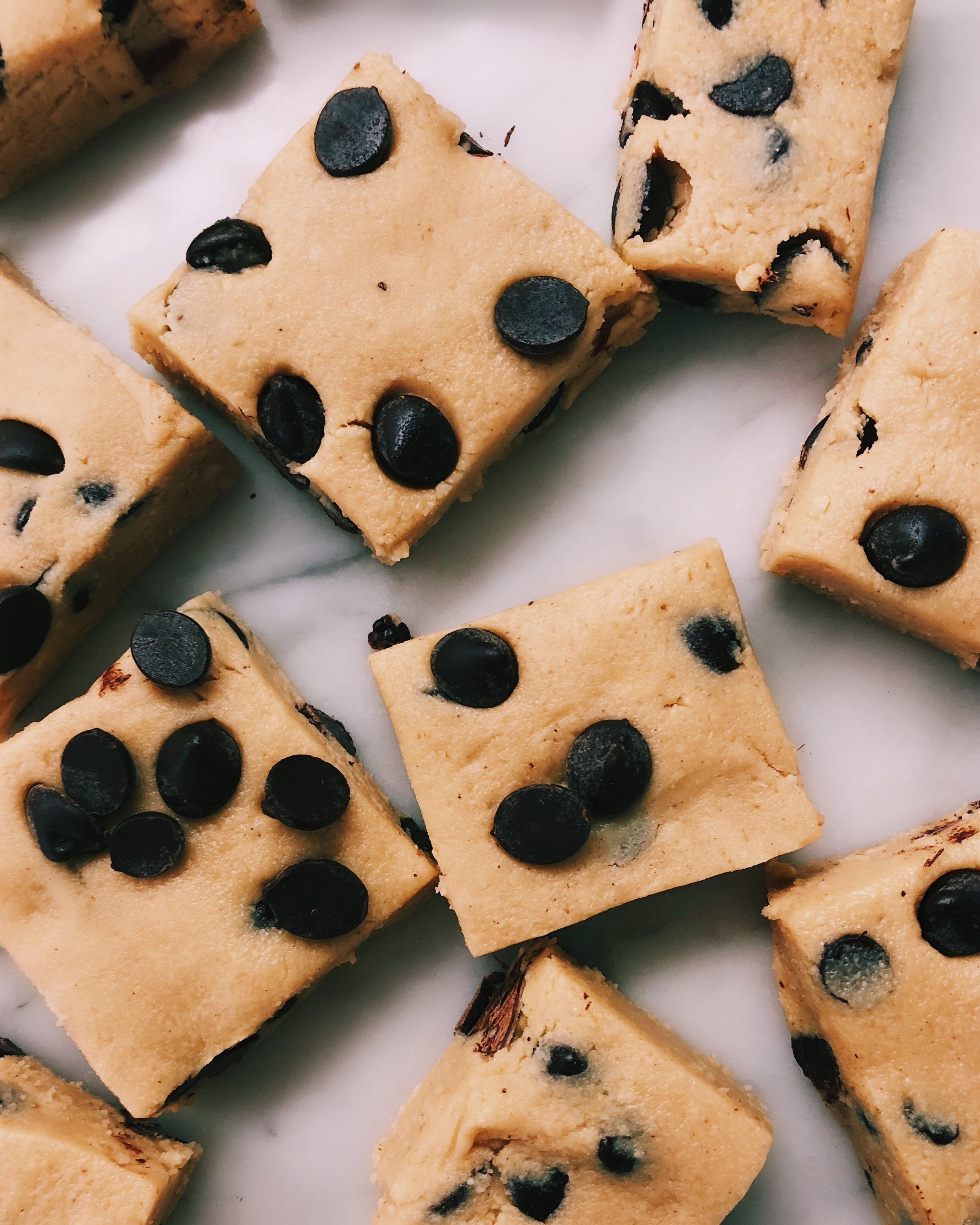 NO BAKE COOKIE DOUGH FUDGE - INGREDIENTS3 cups cashews1/4 cup coconut flour1/4 cup melted Wedderspoon raw beechwood honey1/2 tsp vanilla1/2 tsp cinnamon or nutmeg1/4 tsp salt6 tb melted coconut oil1 cup dairy free chocolate chips