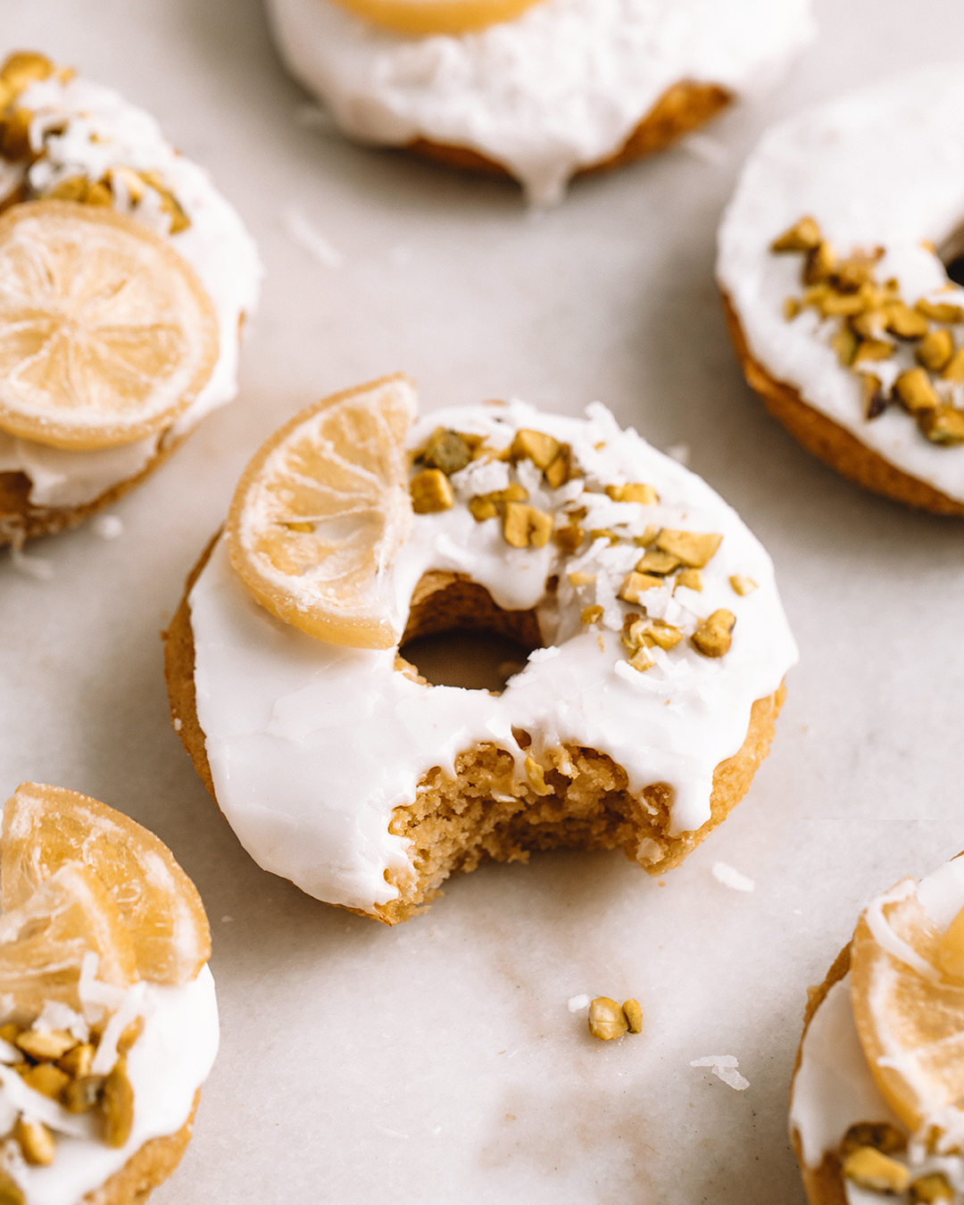 LEMON PISTACHIO DONUTS - INGREDIENTSDONUTS:1 cup gluten free flour (I use Bob's red mill gluten free 1:1 baking flour)1/2 cup coconut sugar1/2 cup apple sauce1/4 cup olive oiljuice of one lemon1 tsp baking poweder1/8 cup non-dairy milk (or coconut milk)1/8 cup bone broth (optional: if omitting, substitute with 1/8 cup non-dairy milk)1 tb lemon zest1/2 cup shredded coconut (I like sweetened for this recipe)pinch sea saltLEMON GLAZE:1 1/2 cups powdered sugar2-3 tb lemon juice1/2 cup chopped pistachiosshredded sweetened coconut