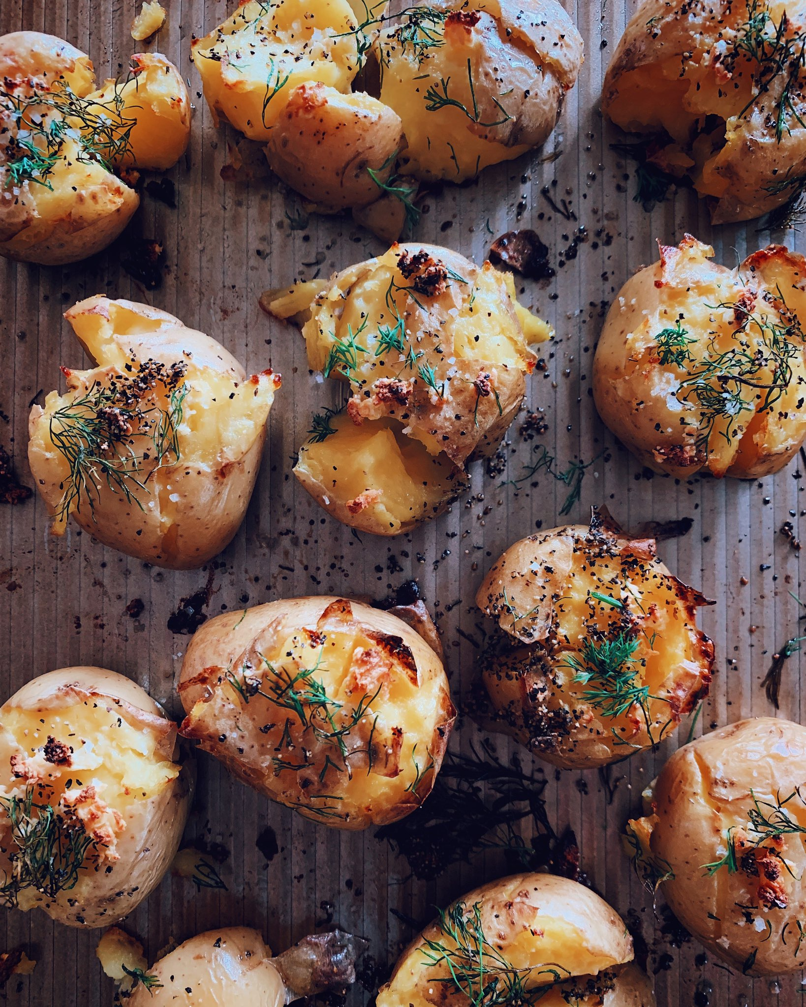 GARLICKY SMASHED POTATOES - INGREDIENTS1 1/2 pounds yellow potatoes4 cloves garlic, pressed2 tb olive oil, or you can use a spray2 tb chopped fresh dillsalt and pepper to taste