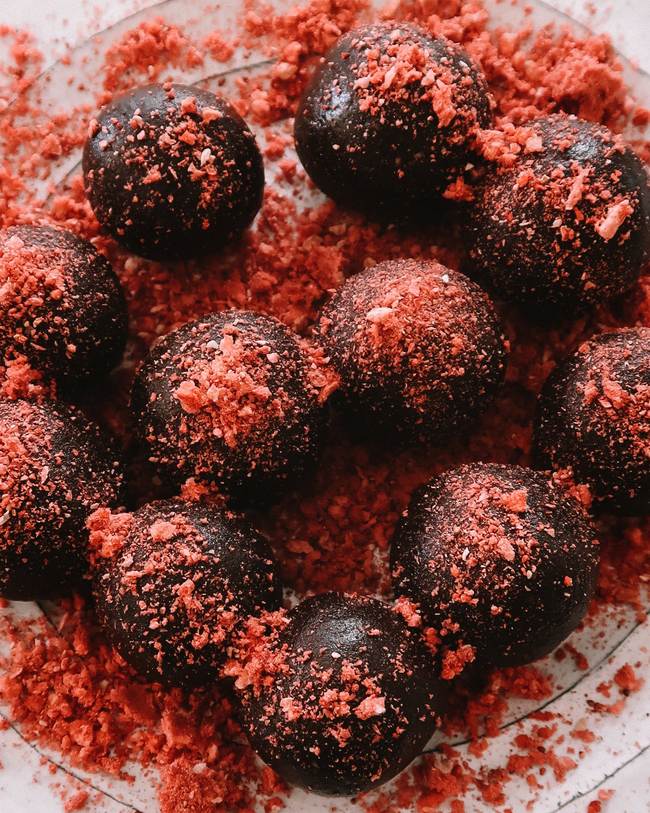 STRAWBERRY HAZELNUT BITES - INGREDIENTS3/4 cup hazelnuts (raw and unsalted)1/2 cup almond butter1/2 cup (about 6) medjool dates, pitted4 tablespoons cacao powder1 tsp vanilla extract 3/4 cup powdered freeze dried strawberries (one bag)