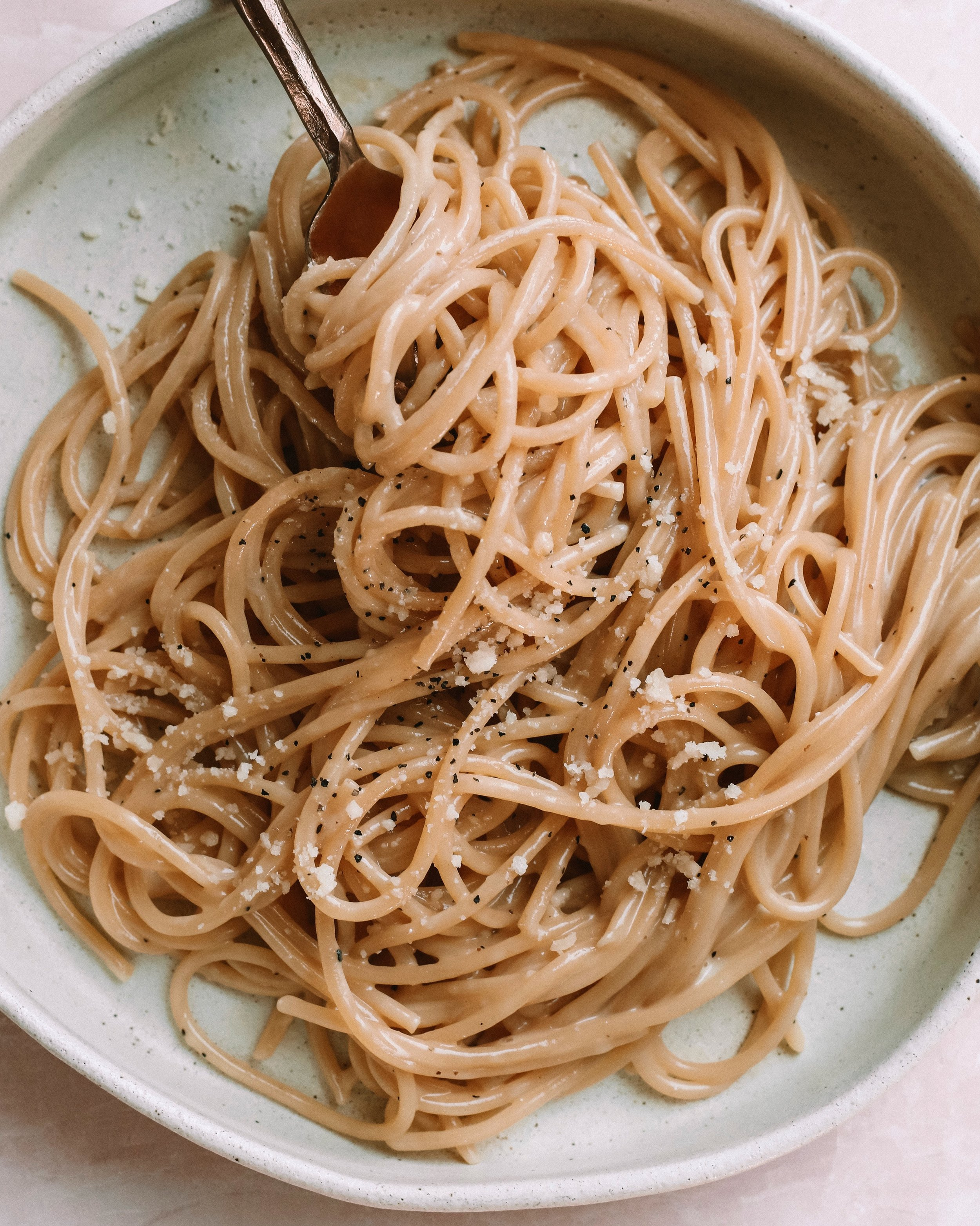 CACIO E PEPE - INGREDIENTSone package Eat Banza Chickpea Spaghetti pasta3 tb Organic Pastures Raw Salted Butter1 tb olive oil2/3 cup raw parmesan cheese1 egg yolk2 tsp ground black pepper