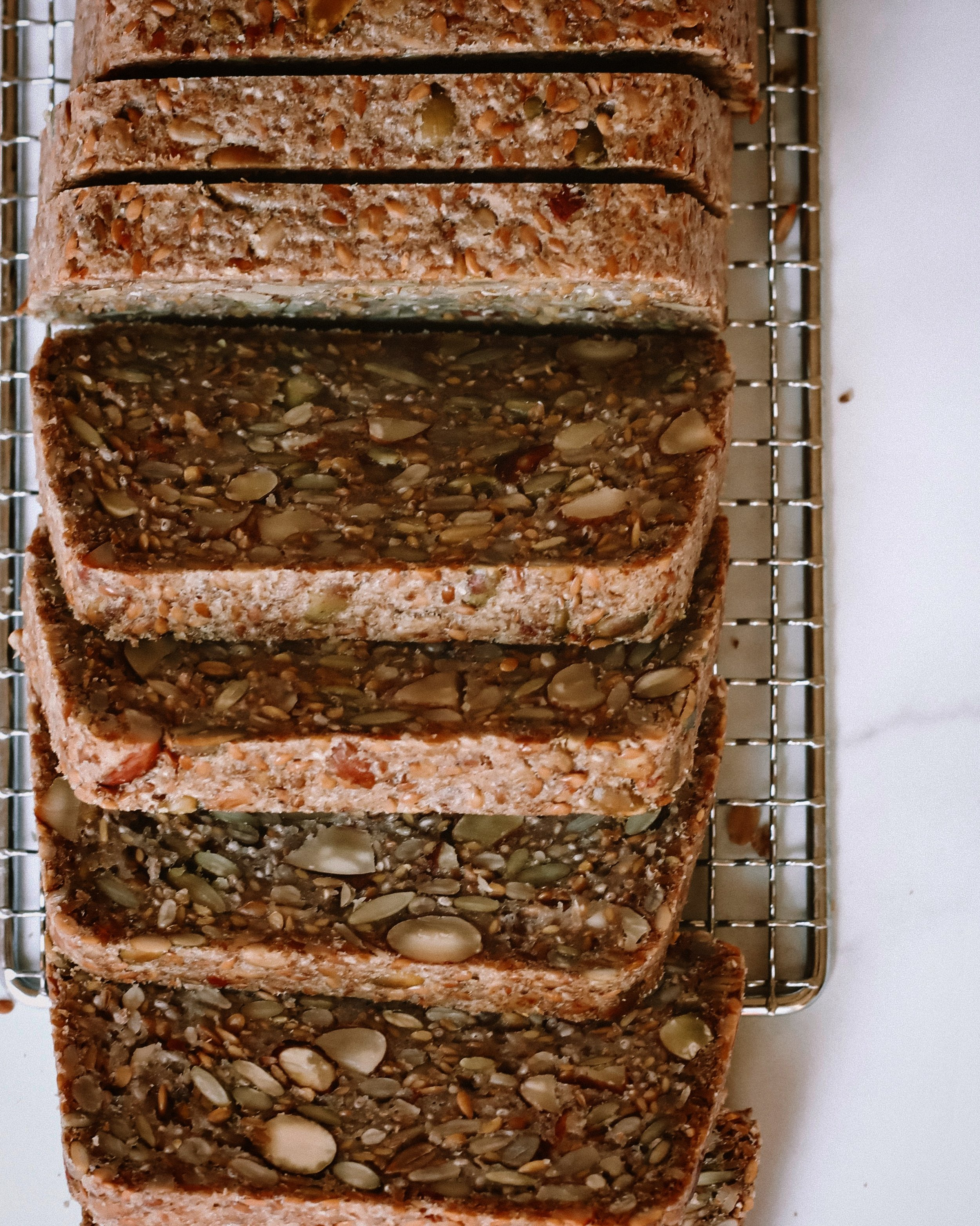 GRAIN FREE SEED + NUT BREAD - INGREDIENTS1 cup cassava flour 1 cup pumpkin seeds1/3 cup raw almonds2/3 cup flax seeds (the whole seed)1/2 cup sunflower seeds3 tsp chia seeds1/4 cup psyllium husks (flakes, not powder)1 tsp sea salt2 tb maple syrup 1 tb apple cider vinegar1/4 cup melted coconut oil or avocado oil1 3/4 cups water