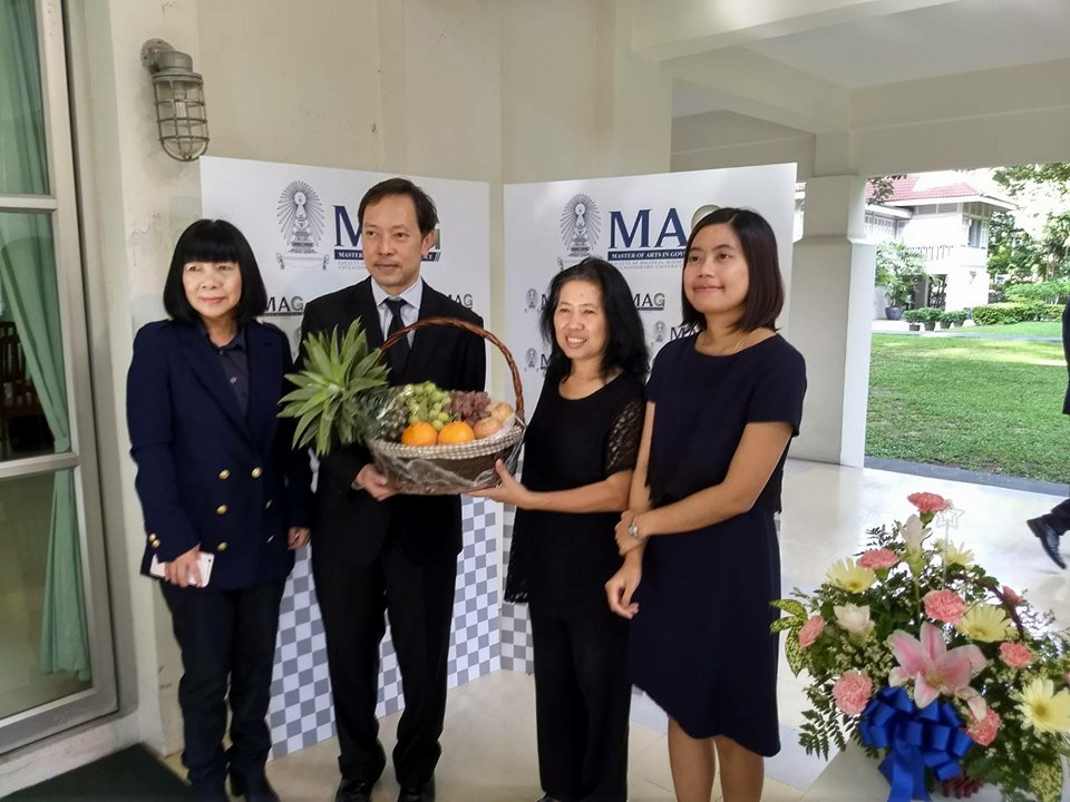 assistant professor dr. naruemon thabchumpon, director, maids program, presents a fruits basket to assistant professor dr. ackadej chaiperm, director, mag program