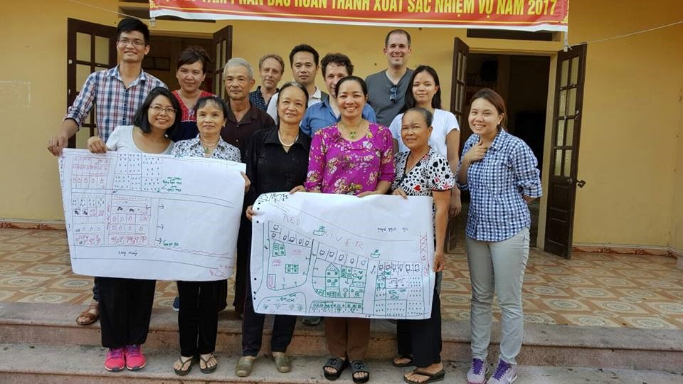 Locals draw mapping of their current and future village under the support of our group.  Source: KNOTS Facebook