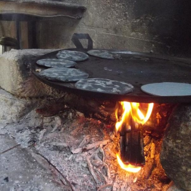 Beautiful blue corn pinole tortillas on the griddle over an open fire. Yum! #pinole #ContinueTheLegacy #Mexico #ultrarunning #tortilla