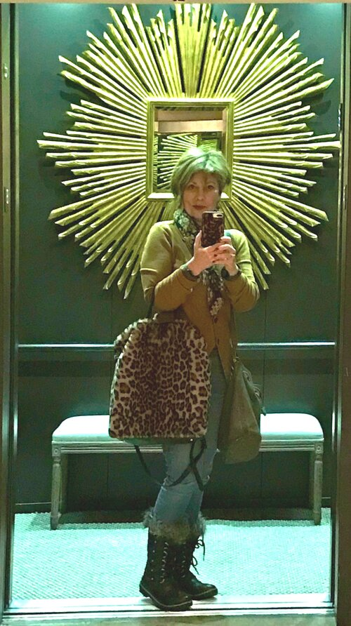 Deb in the midst of a soul-satisfying Micro-Adventure at RH Chicago. This is a peak elevator experience.