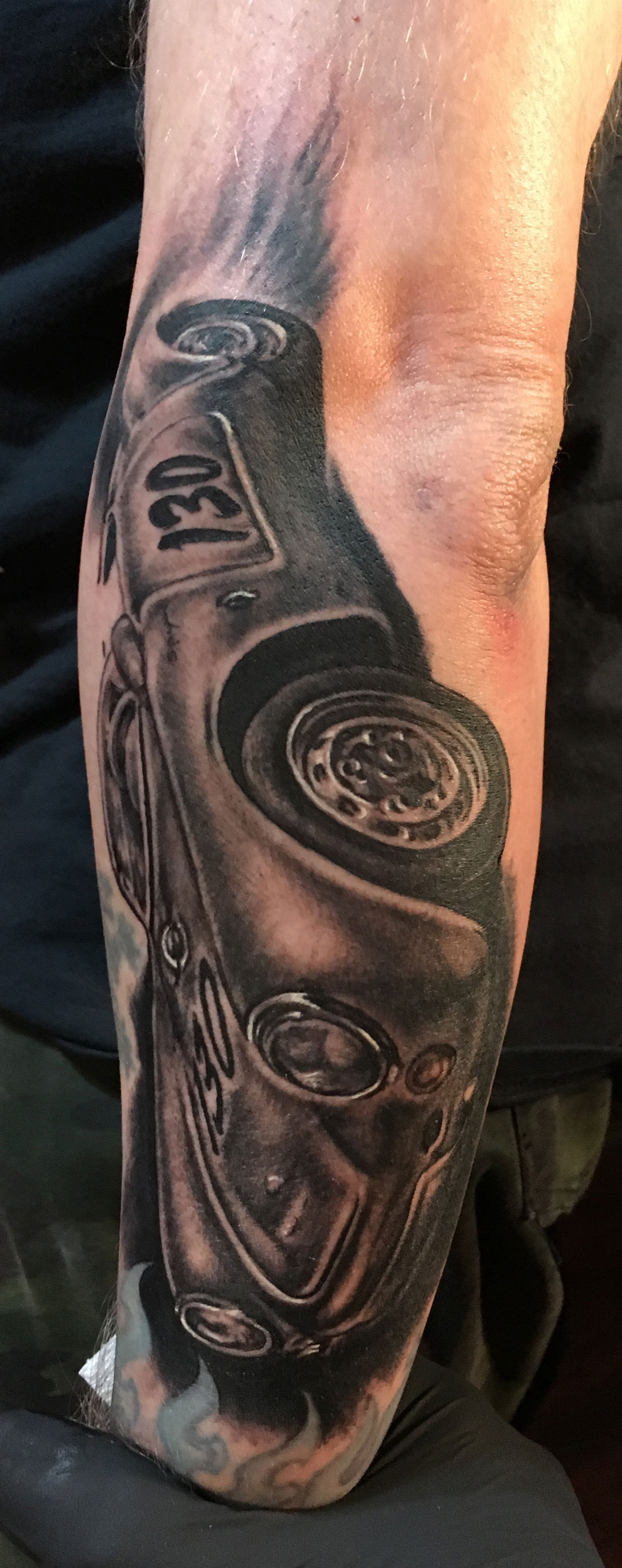 "Black and Grey Portrait Tattoo of ""Little Bastard"", James Dean's Infamous Porsche 550 Spyder which he tragically drove to his death in 1955."