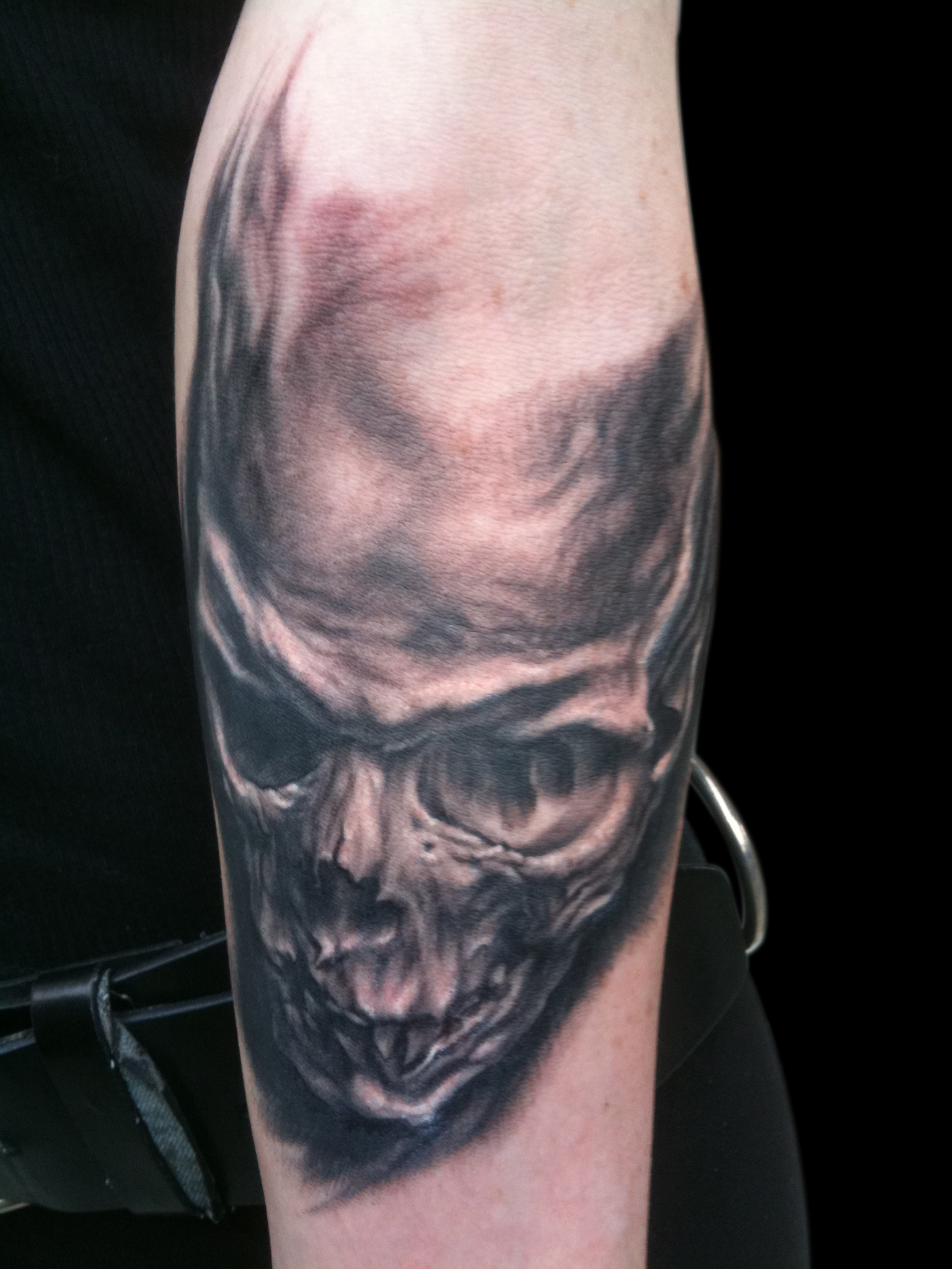 Black and Grey Forearm Skull Tattoo on  Razor Candi , (fresh) Transilvania Tattoo Expo, Romania  First session on surreal bone half sleeve that is now complete.  (Click link above to see a bit more)