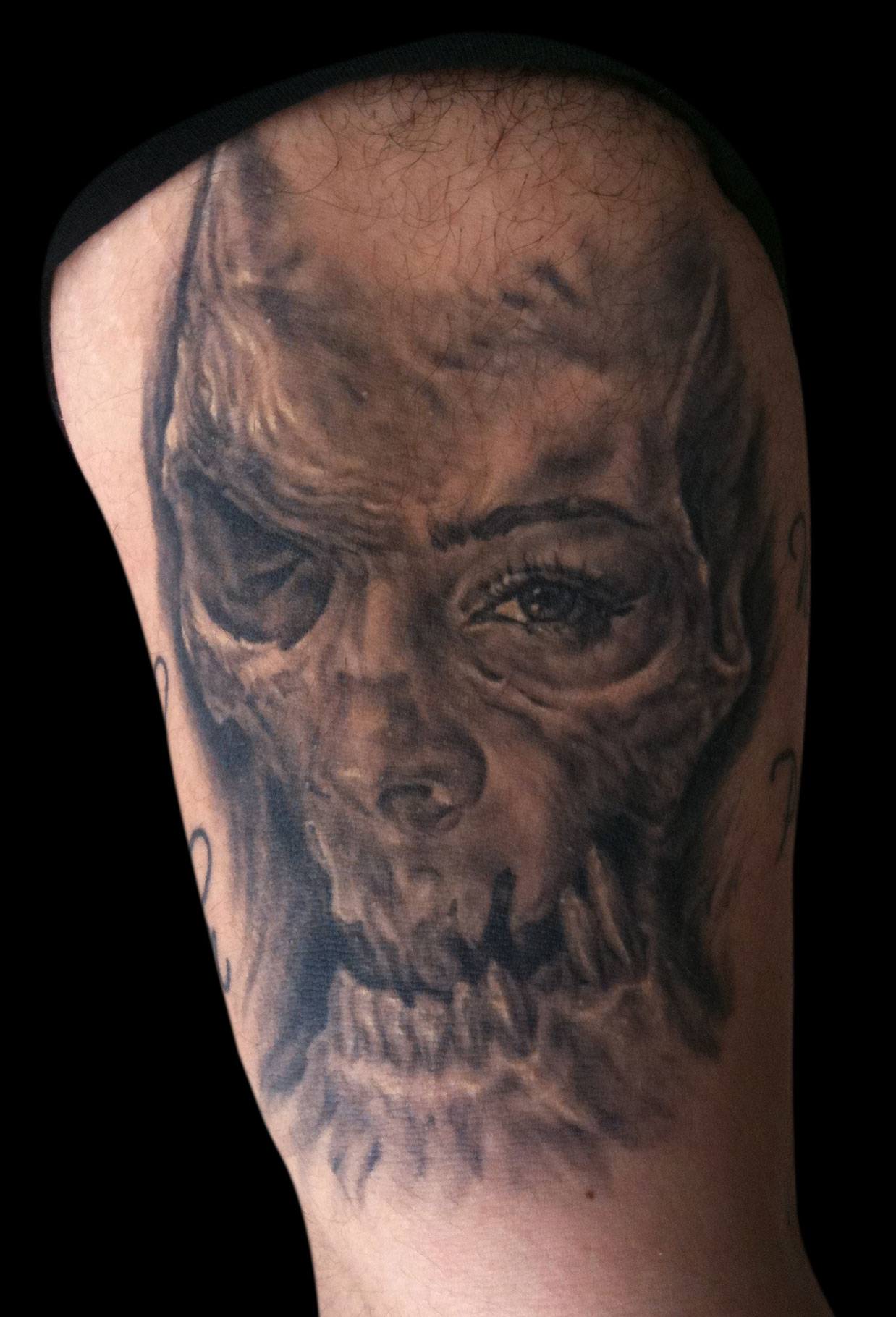 Black and Grey Skull/Woman Face Tattoo 1, (healed)