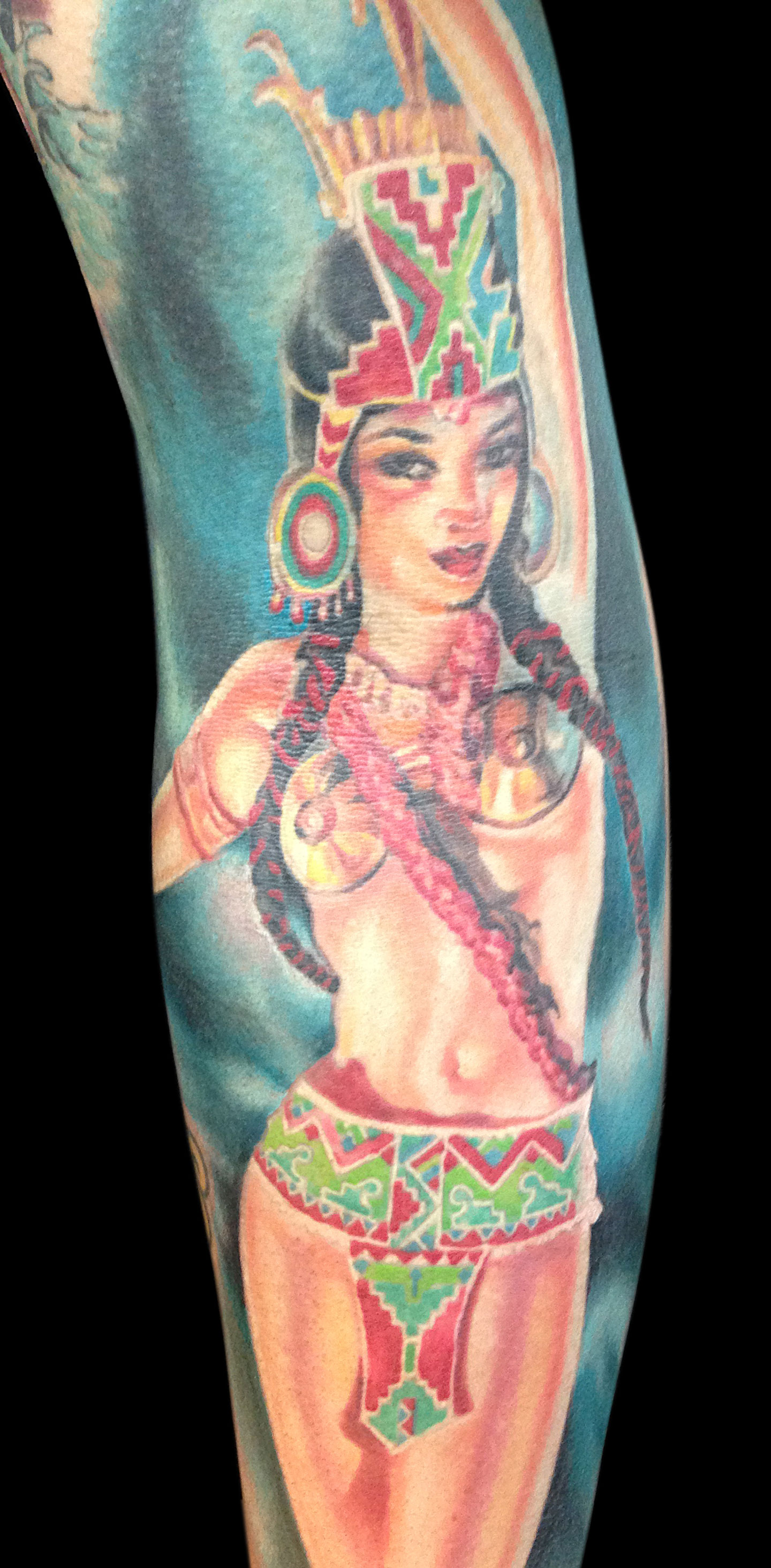 Aztec Fire Goddess Color Pin Up Tattoo on Gloria Conners, (entire tattoo and figure is 3 years healed in this photo, except for a small portion of the turquoise background on the bottom is fresh) detail zoom