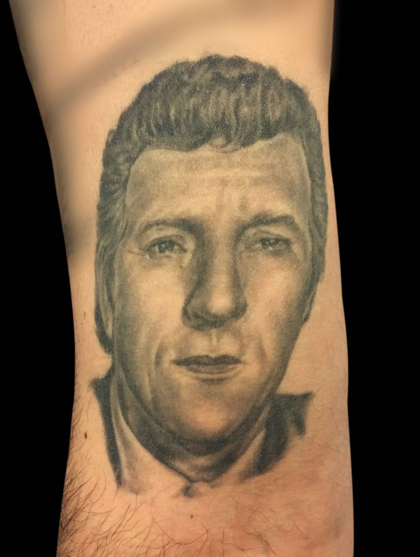 Black and Grey Memorial Portrait Tattoo of Brother, (tattoo is healed and 4 years old in this photo)