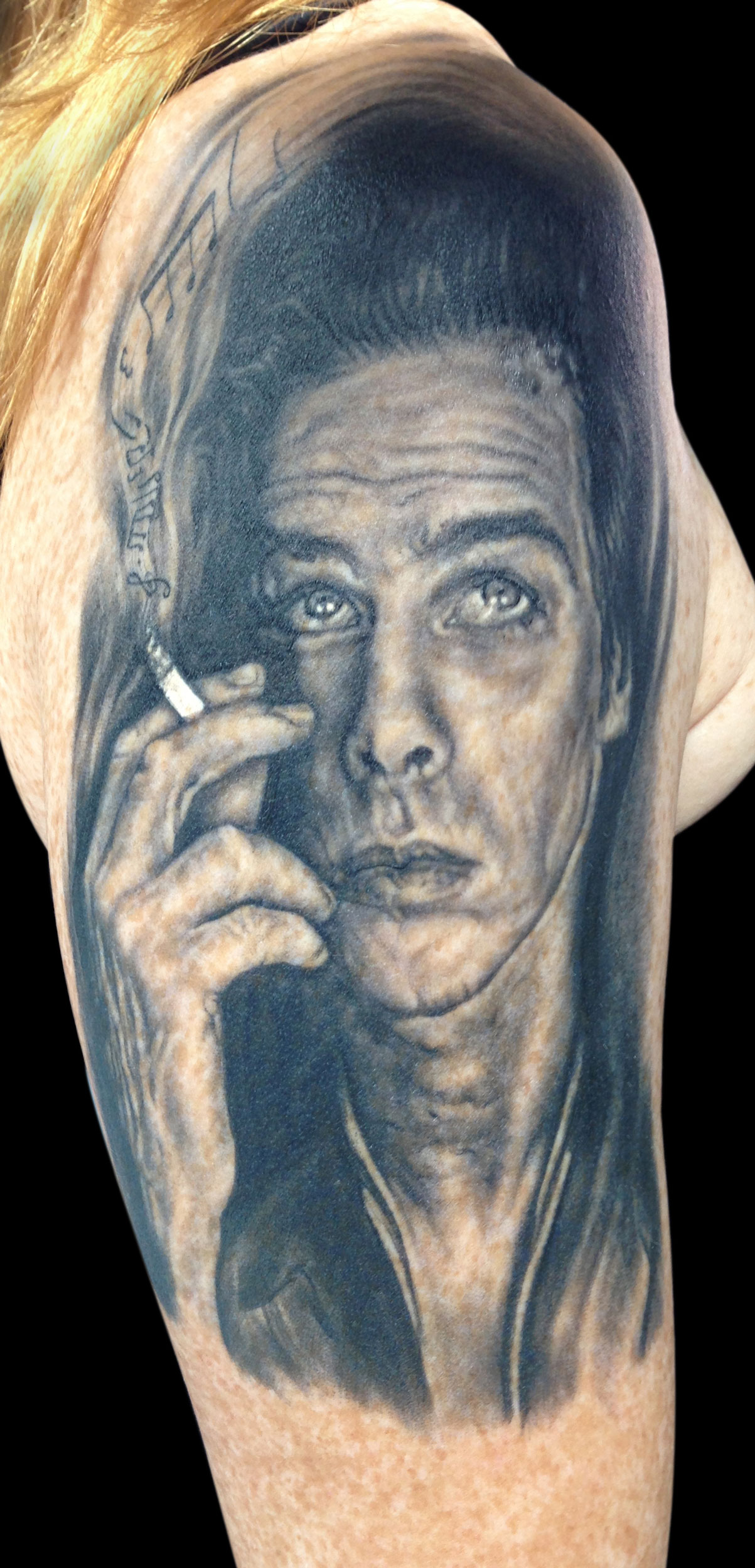 Black and Grey Nick Cave Portrait Tattoo with Musical Cigarette, (healed)