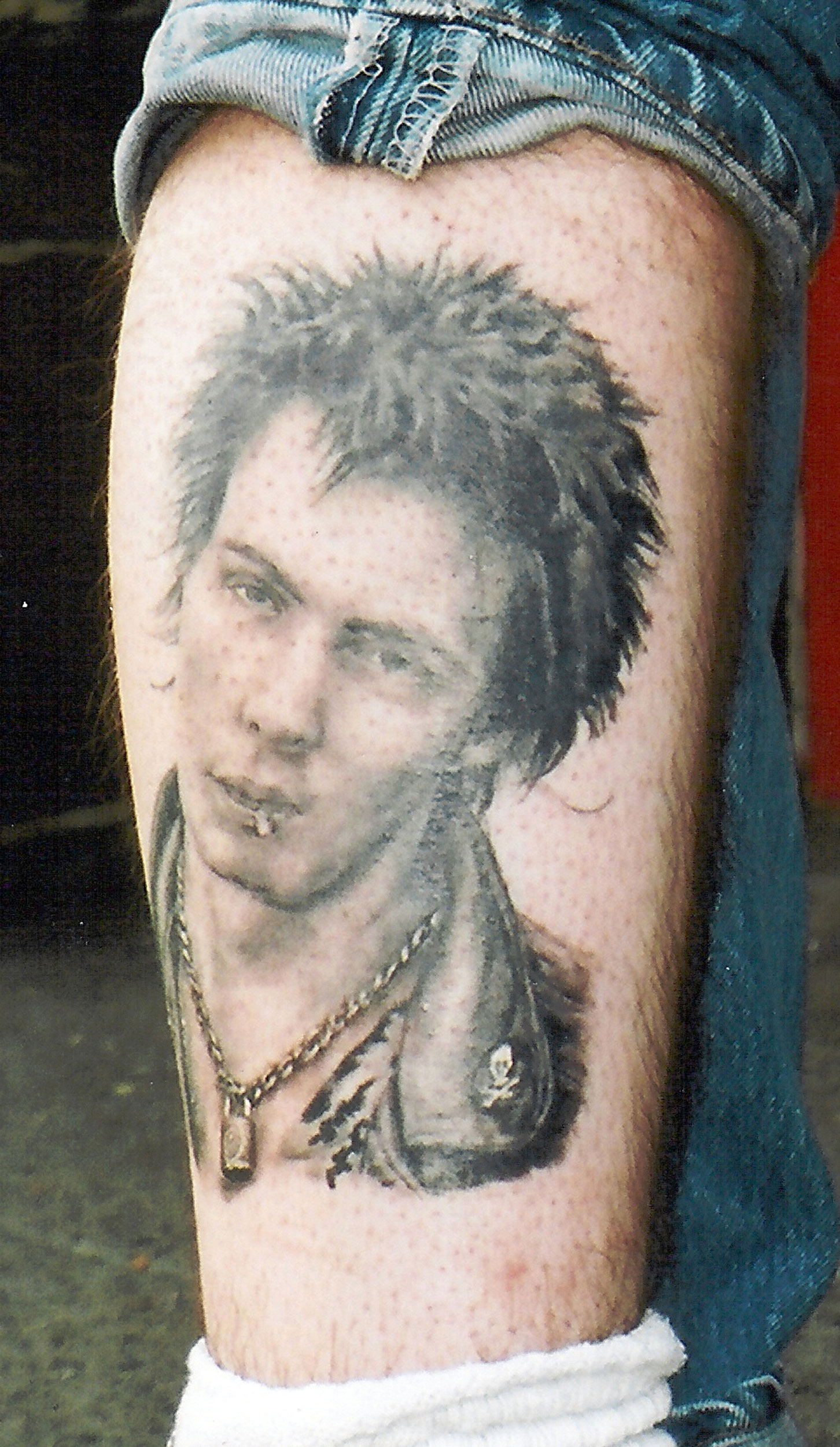 Black and Grey Sid Vicious Portrait Tattoo, (healed) tattooed in 2000