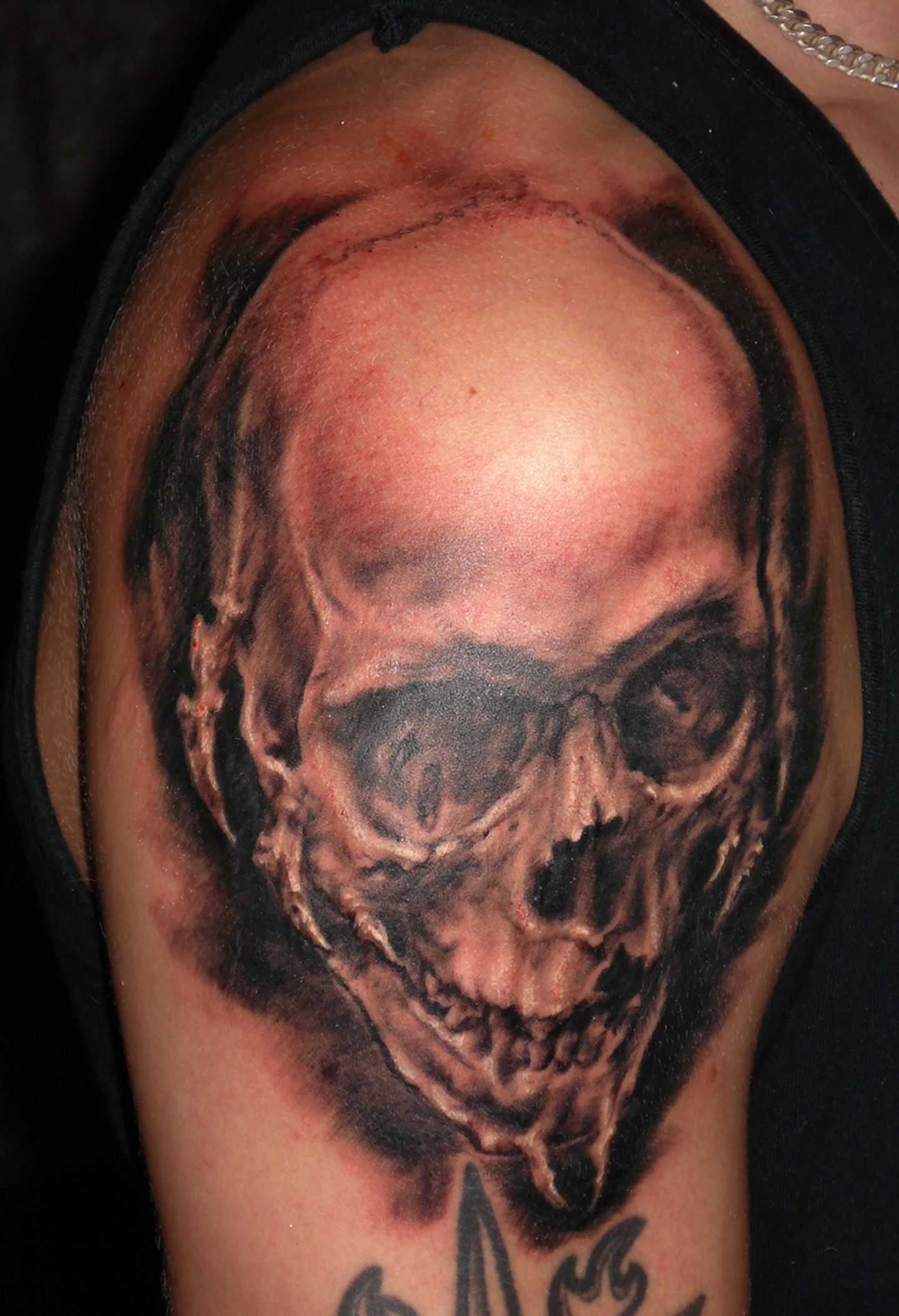 Black and Grey Spiky Skull Upper Arm Tattoo, (fresh)