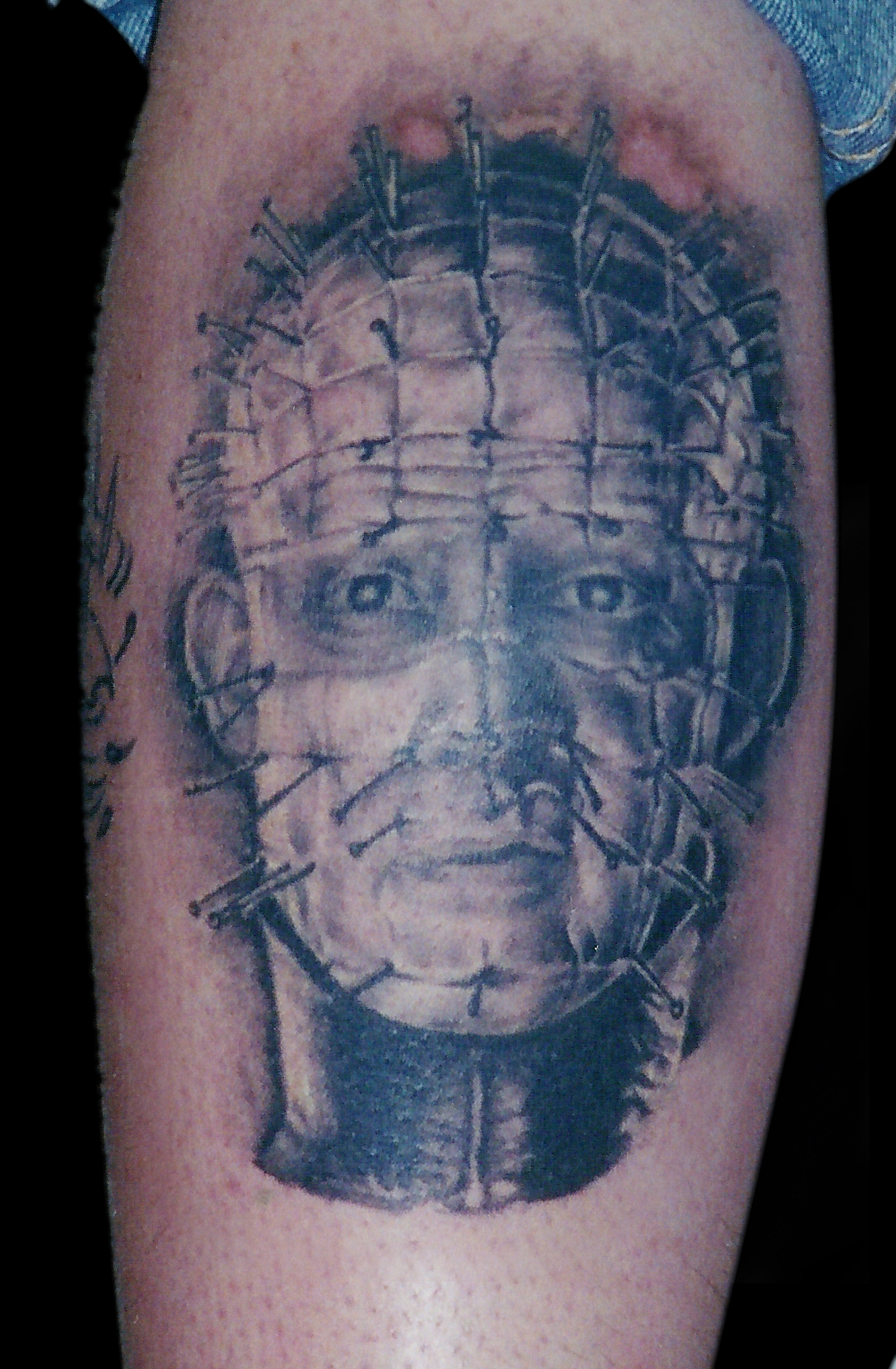 Black and Grey Portrait Tattoo of Pinhead from Hellraiser, (healed) tattooed in 2001