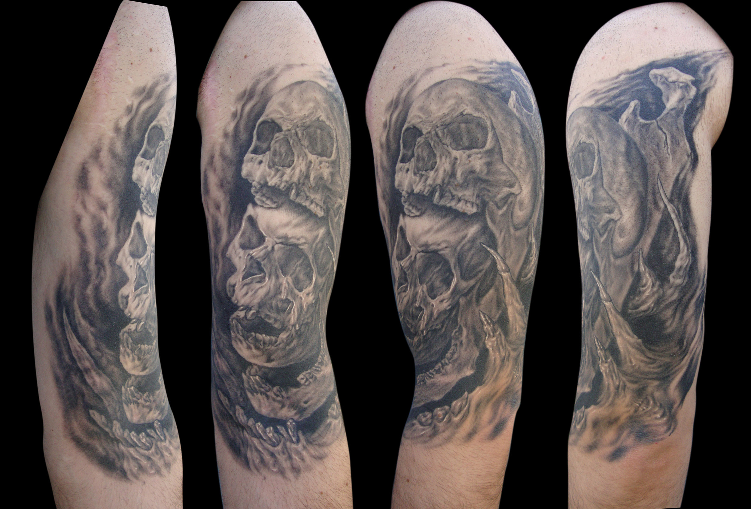 Black and Grey Surreal Multi Skull Overlay Upper Arm Tattoo, (healed) alternate angle photos
