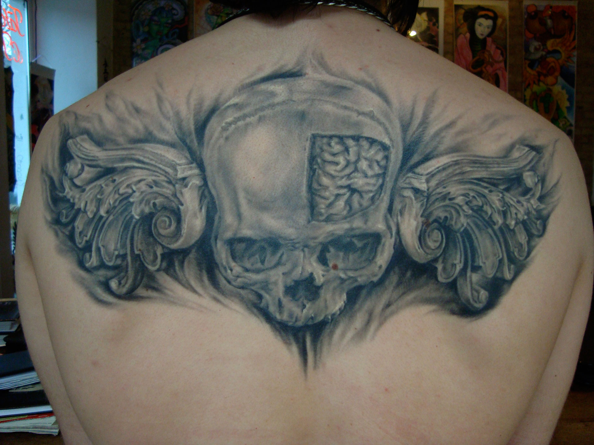 Black and Grey Skull with Ornament Wings and Exposed Brain Tattoo, (healed photo)