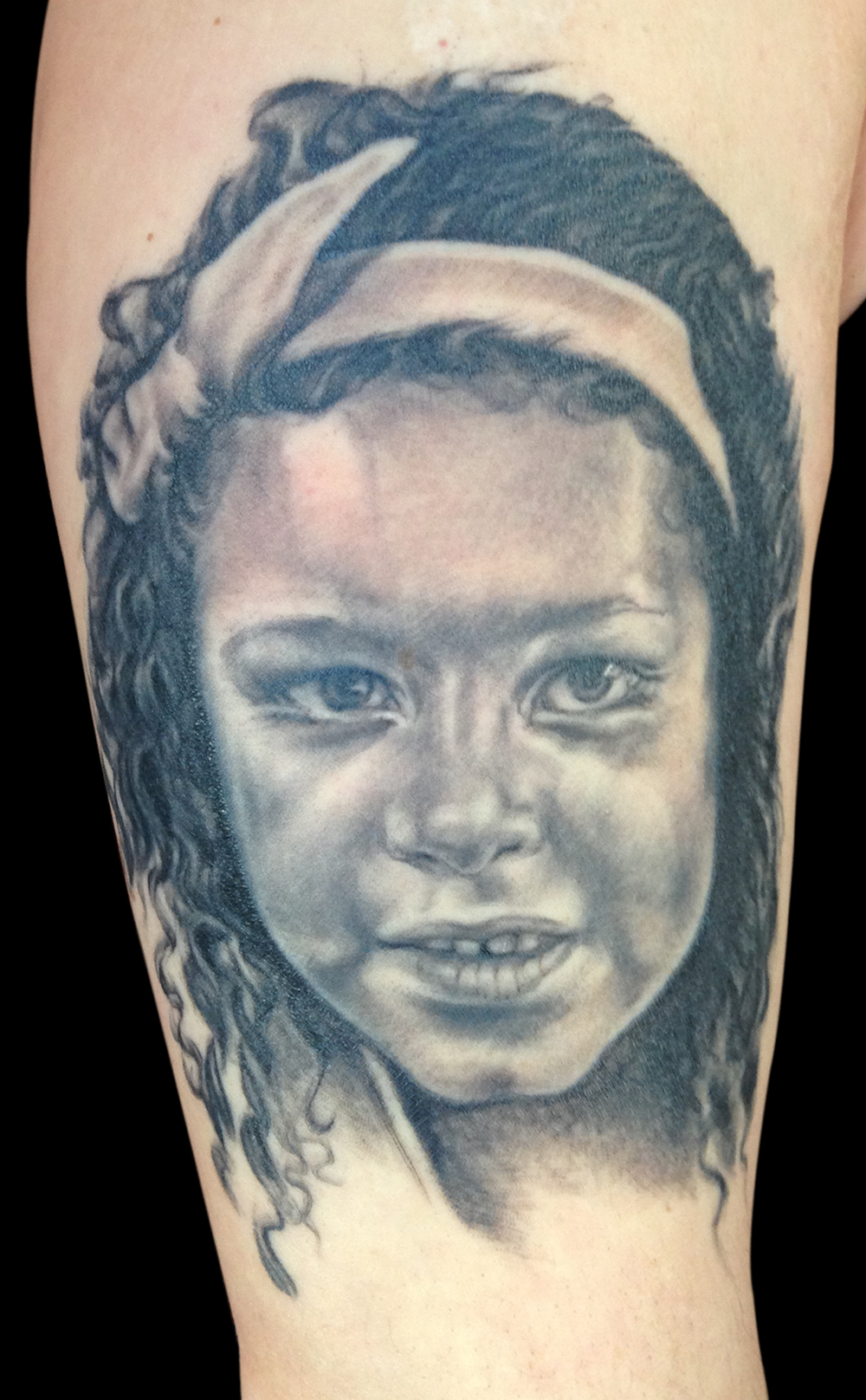 Black and Grey Child Portrait Tattoo, (face is healed, hair and bow are healing)