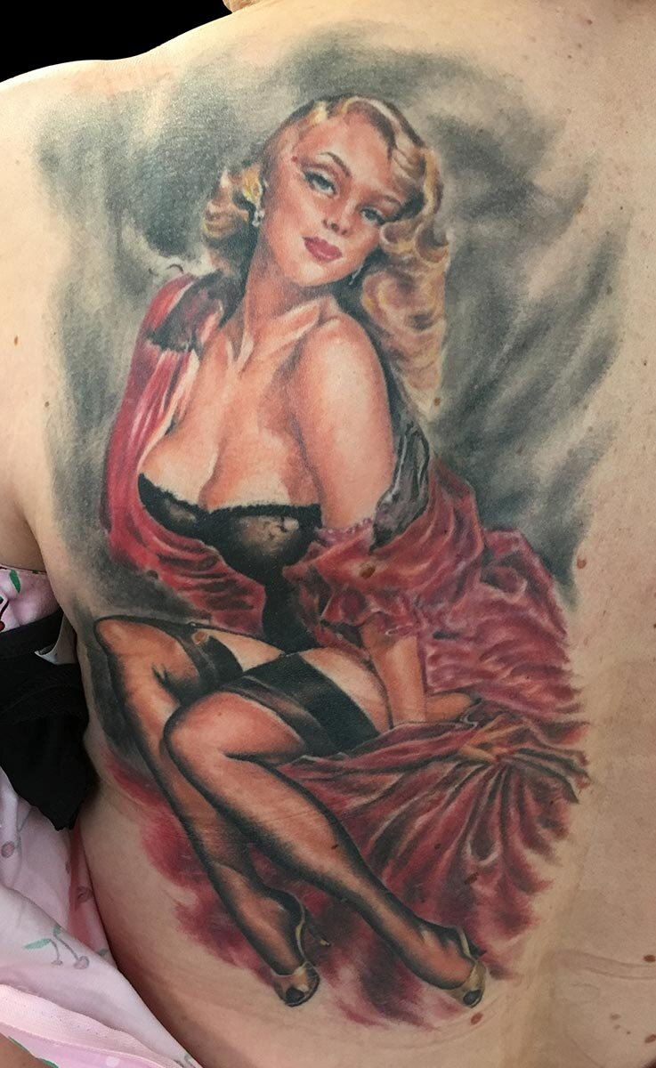 Color Pin Up Tattoo Inspired by Elvgren Reference. Custom modified for the client's personal aesthetic tastes, and better compatibility with the tattoo medium (healed about 2 years in this photo).
