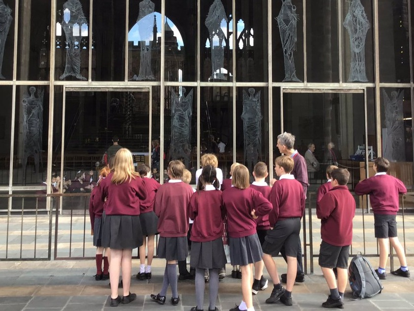 A sunny day meant we could see a vivid and poignant reflection of the old ruins in the glass of the new cathedral.