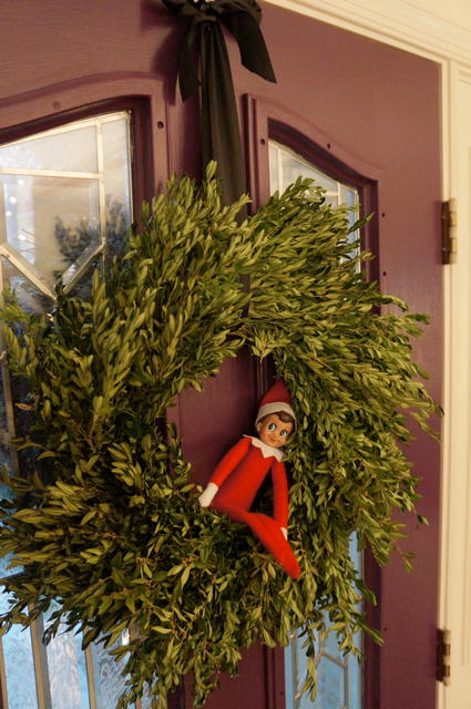 "This is a wreath on the back of our front door. Does anyone hate Elf on a Shelf as much as me? I could write a whole post just about how I wish ""Sparkle"" would take The Big Sleep."