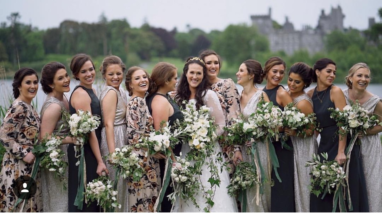 A bride with her maids and their gorgeous dresses!