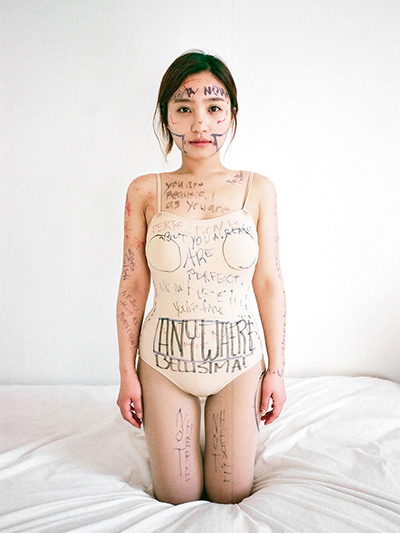 Artist Ji Yeo invites strangers to draw on her body in New York City as part of an art exhibition.