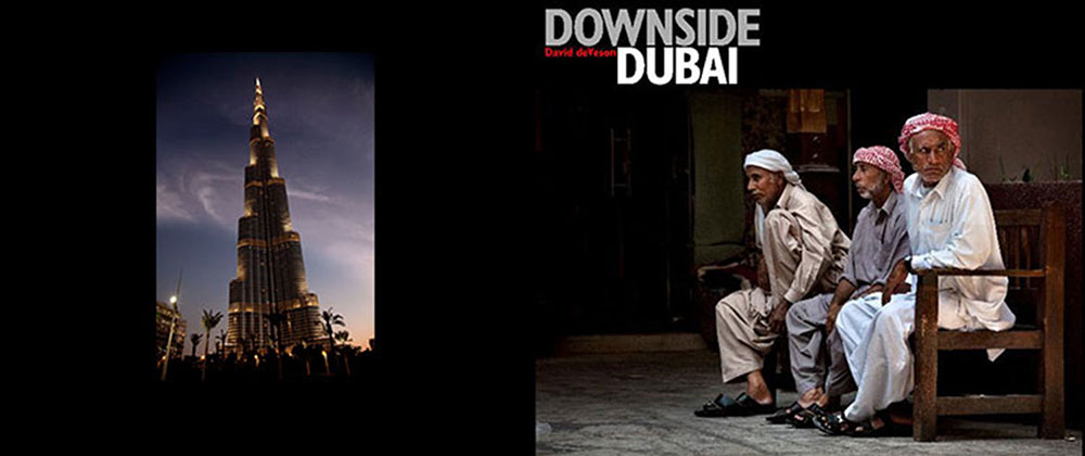 'DOWNSIDE DUBAI'   There are two sides to Dubai and one is slowly disappearing.  The problem is nothing happens slowly in Dubai.  The 180 photographs in this book were taken over a period of three years in which the face of the city changed at a frightening pace, acquiring its new appearance; one of cement monoliths, sparkling glass facades, intertwining overpasses and six lane highways.  This, the upside of the city, has grown relentlessly at the expense of an older culture that risks becoming seen as the city's downside.  All along the wharfs of the Creek and in the Souks which are crushed along its borders, people still carry on with a lifestyle that exists since long before the words 'Anno Domini' came into being.  Slowly but surely Dubai's Downside is being sucked into a way of life as alien to its being as the cement jungle surrounding it.  People who for centuries traded with dhows, bringing continents closer together, now risk finding themselves a mere additional attraction for tourists who come to ski and shop in the luxurious shopping malls that sprout like mushrooms throughout the city.  These photographs are a record of a people who bear little relationship to the brave new world surrounding them.  They are a tribute to a way of life which deserves to be remembered; not in photograph albums or picture postcards, but with respect for an existence that in no way should be considered the downside of anywhere, but rather as the origin of the process that led to the city that proudly calls itself Dubai.