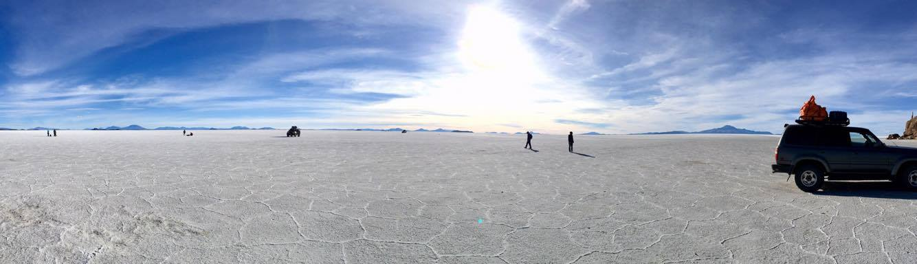 We arrive in the midst of the salt flats after a short drive. Though the vast white plains make be mistaken for snow from afar, this is in fact the world's largest salt flat, spanning 10,582 square kilometers (4,086 miles).