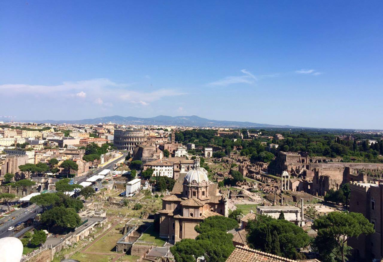 For a fee, visitors can take an elevator to the very top of the monument for views of the city and nearby  Roman Forum  (pictured here).