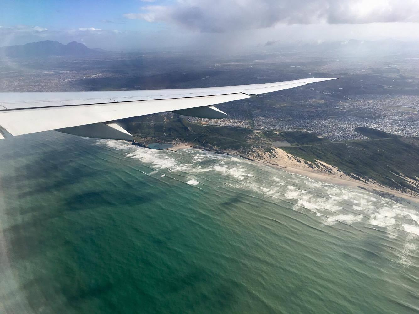 Flying in to the Cape Town airport. Remember that summer in the Northern Hemisphere is 'winter' here, so bring clothes for chilly weather!