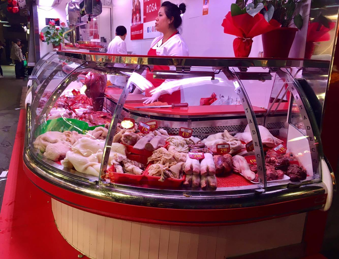 A butcher selling pig hooves, and tripe. Dim sum, anyone?