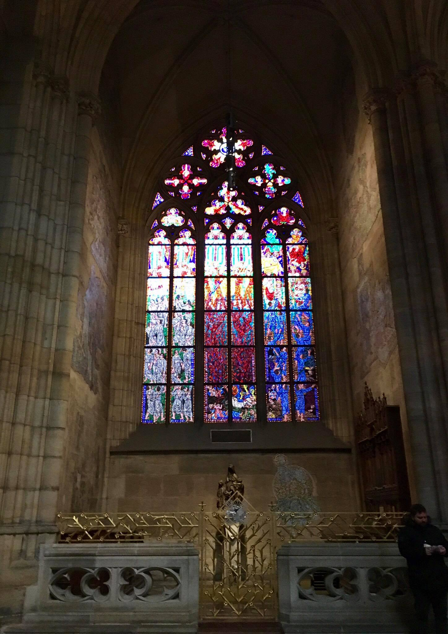 A stunning stained-glass window off to one side of the cathedral.