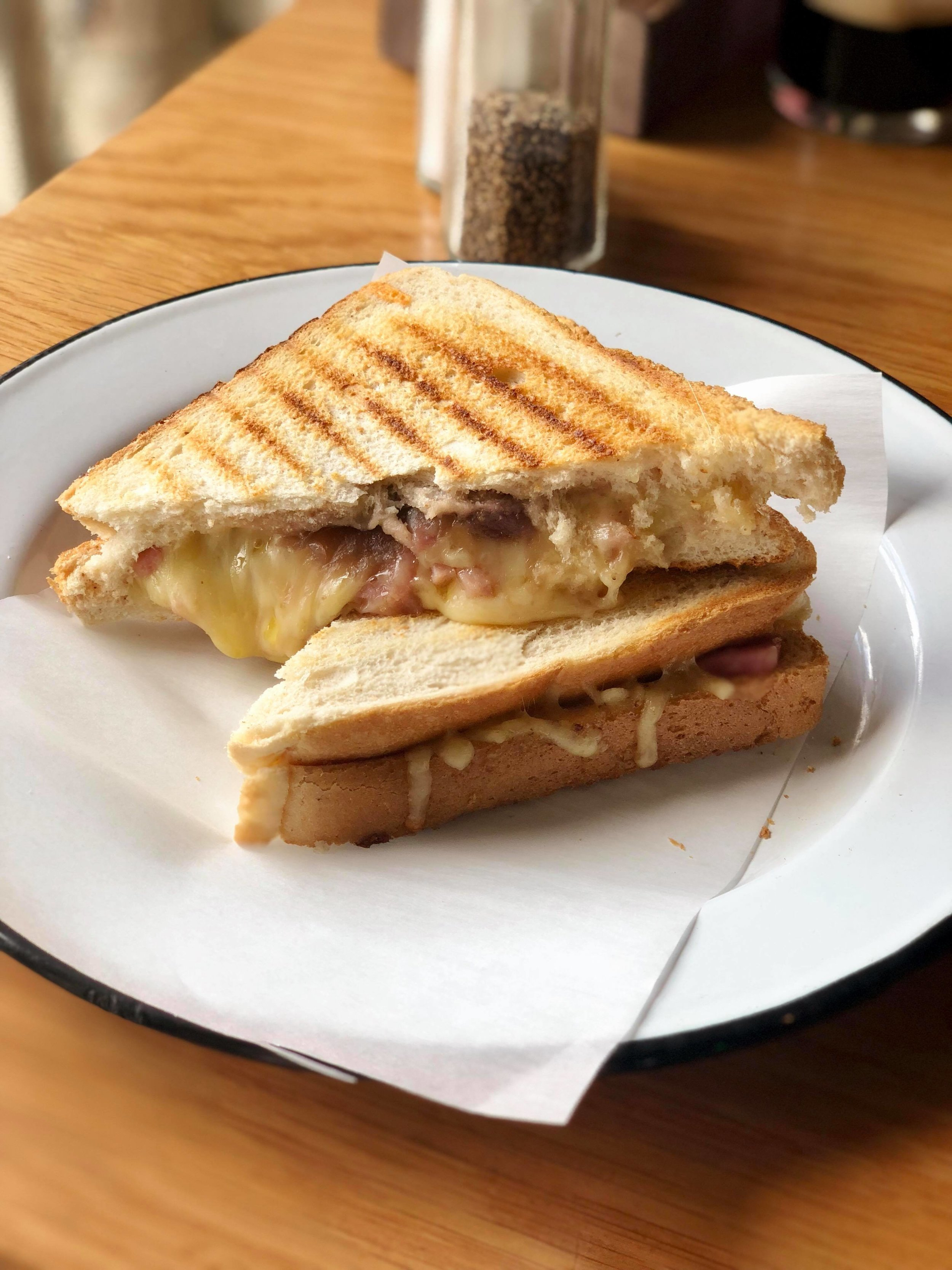 - Unbelievably satisfying grilled patty melt with layers of melted cheese, bits of Irish ham, and Guinness infused caramelized onions. Maybe it was the beer, or maybe it was just that good.