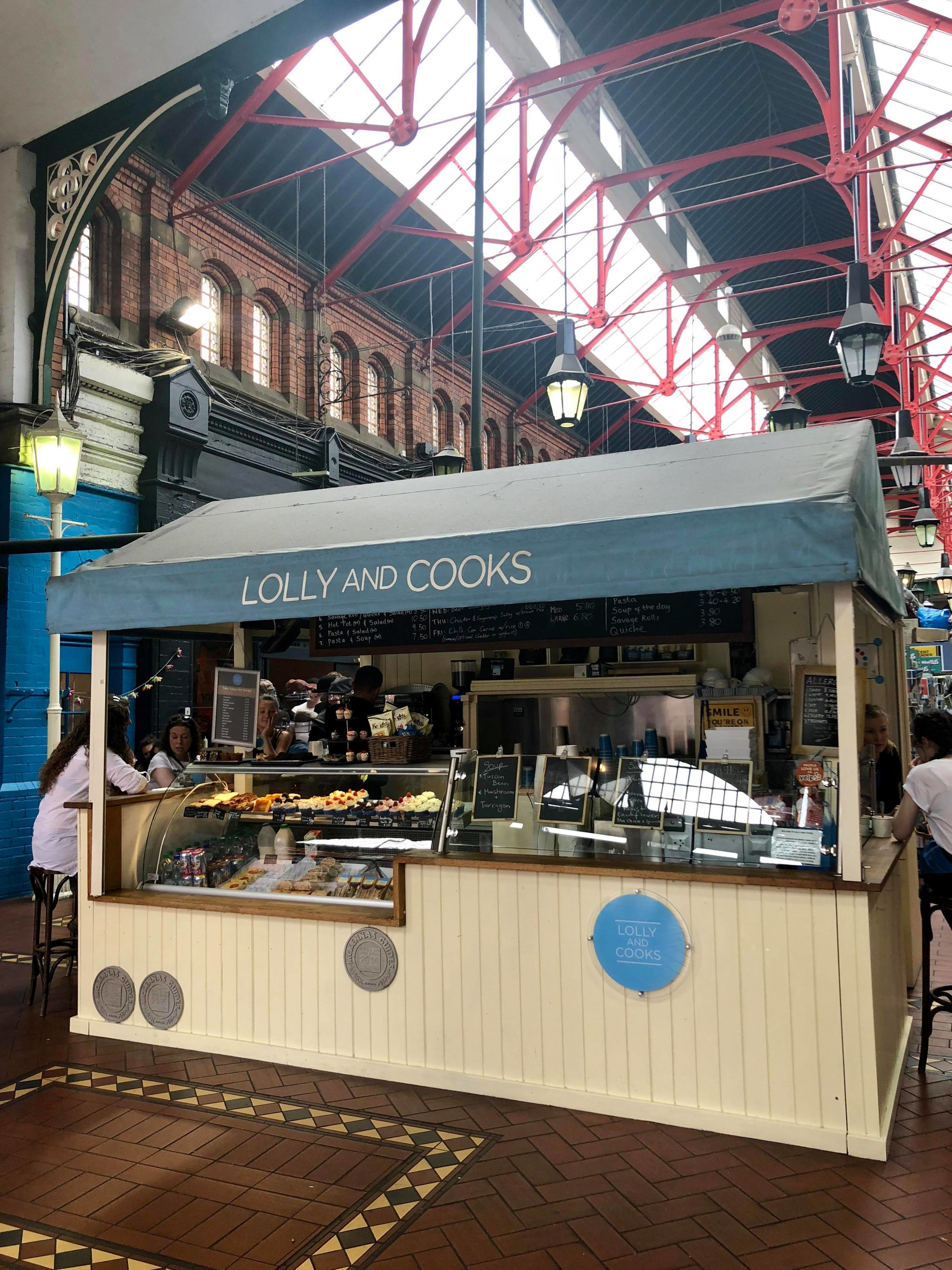 - Located in the Market Arcade in the city-center (seen above), Lolly and Cooks has a stand in the middle of the hall here.