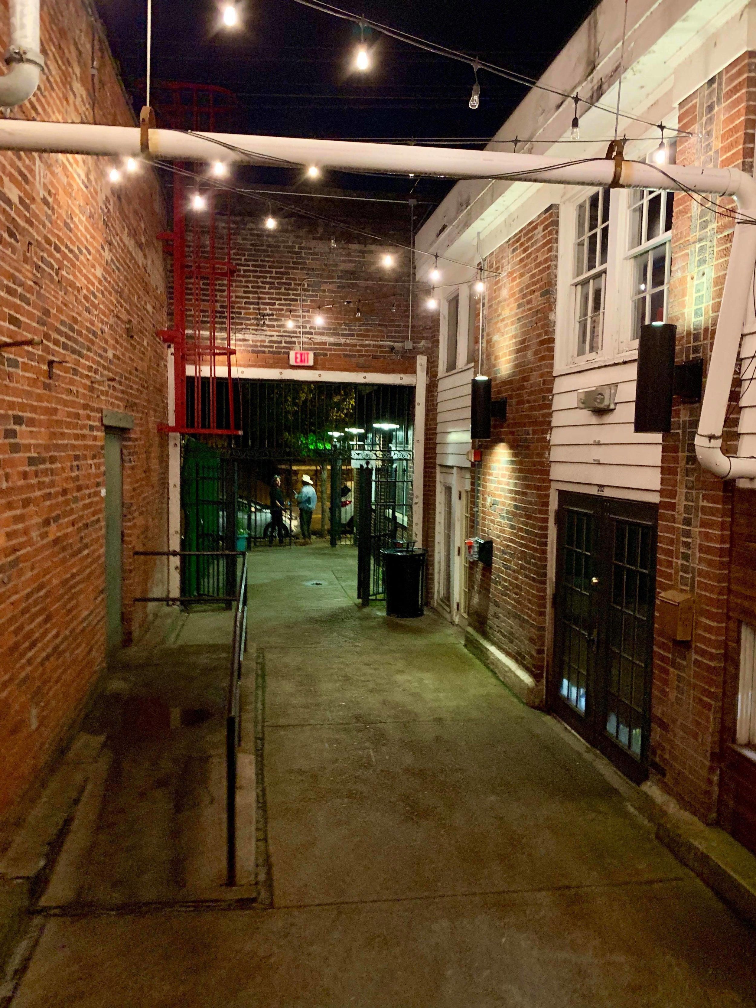 - With its entrance located in an alleyway, Old Glory might be the most mysterious place to grab a drink in all of Nashville.