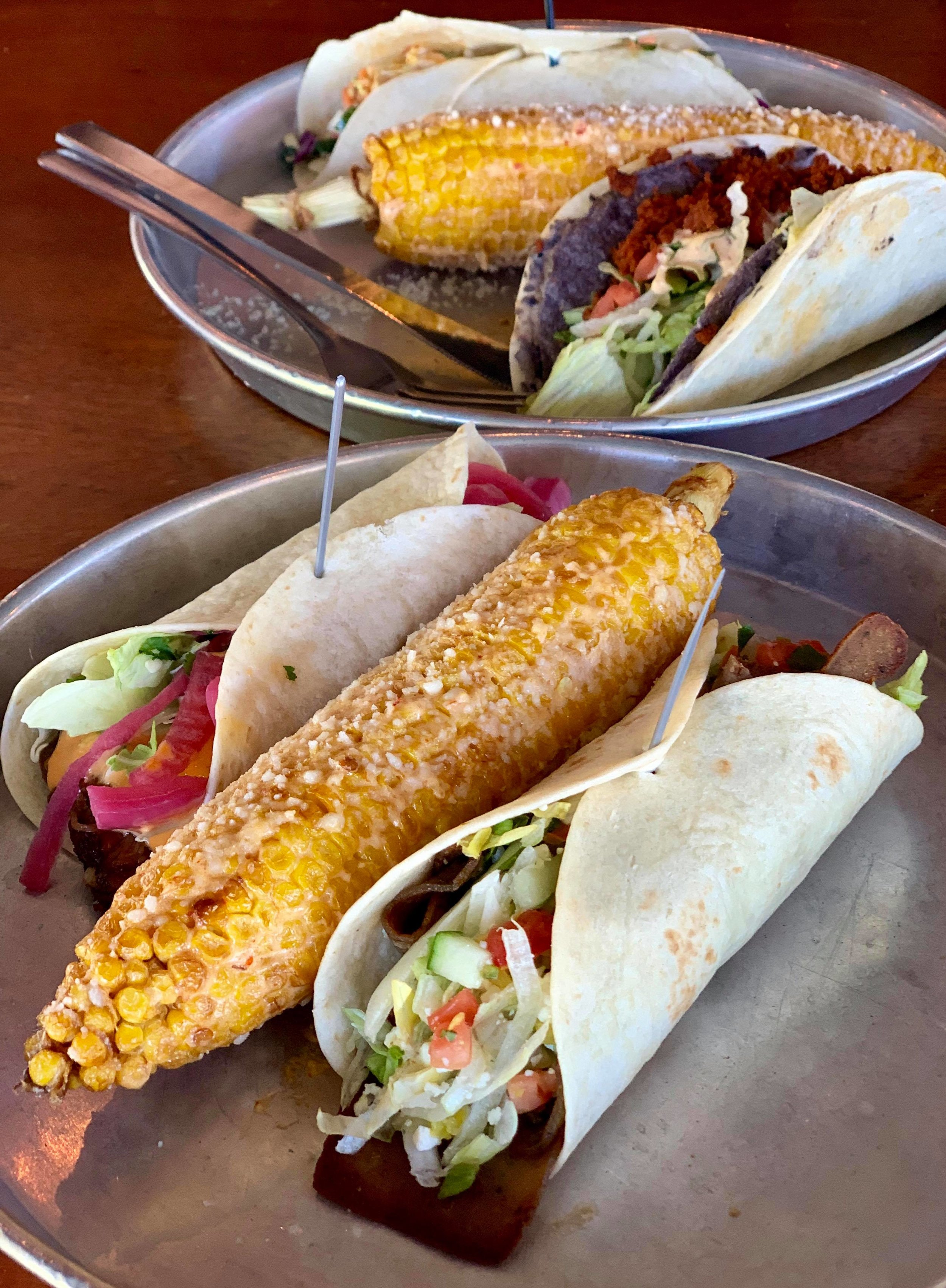 - A Nashville favorite, Taco Mamacita offers patrons a selection of any two tacos and a side for $10. Side pictured is Mexican street corn.