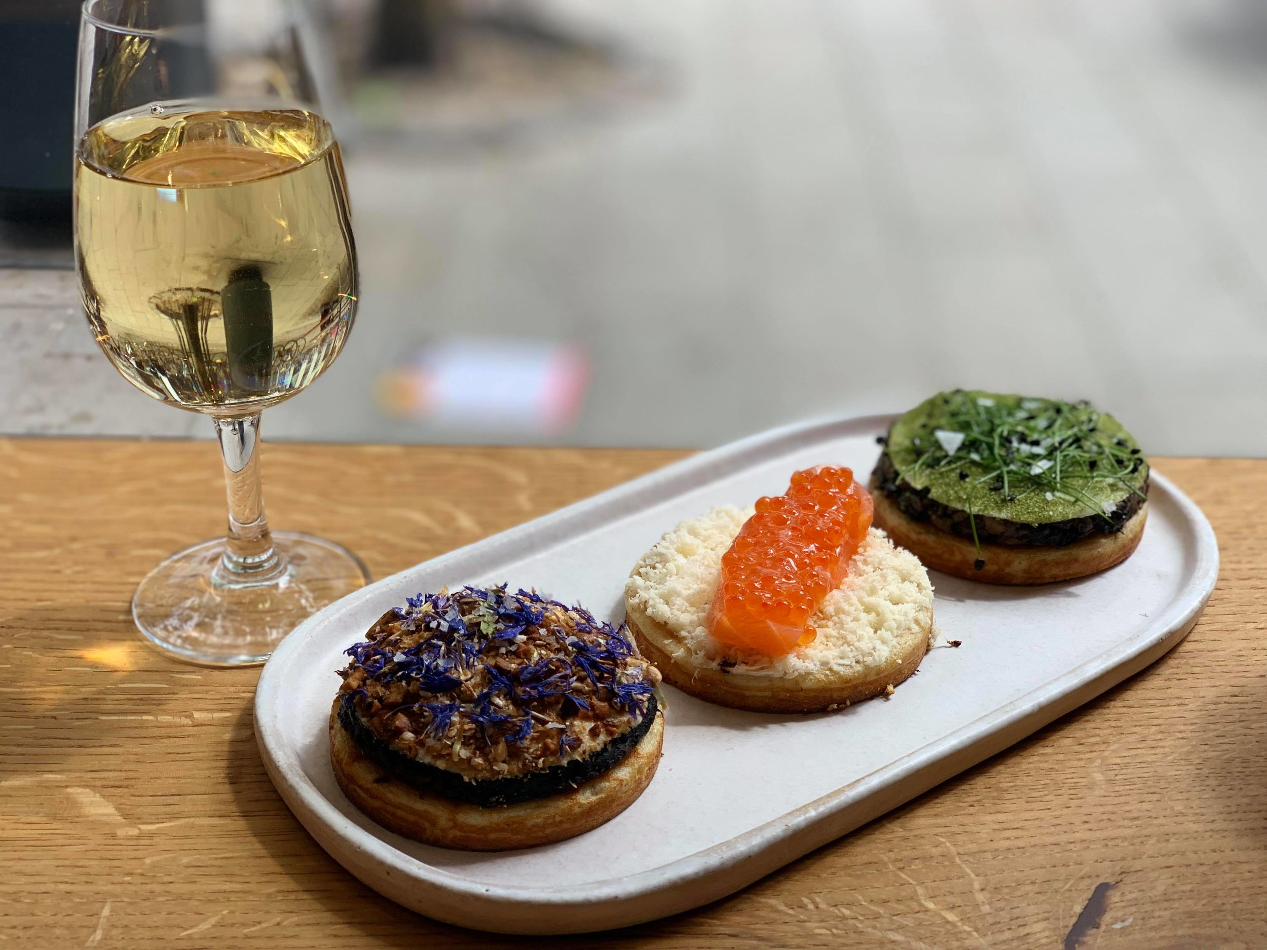 From left to right,  celeriac & cornflower  (with roasted buckwheat & sunflower seeds),  salmon & horseradish  (with trout roe and brown butter),  garlic fried mushroom & daikon ( with rock chives & kale powder)