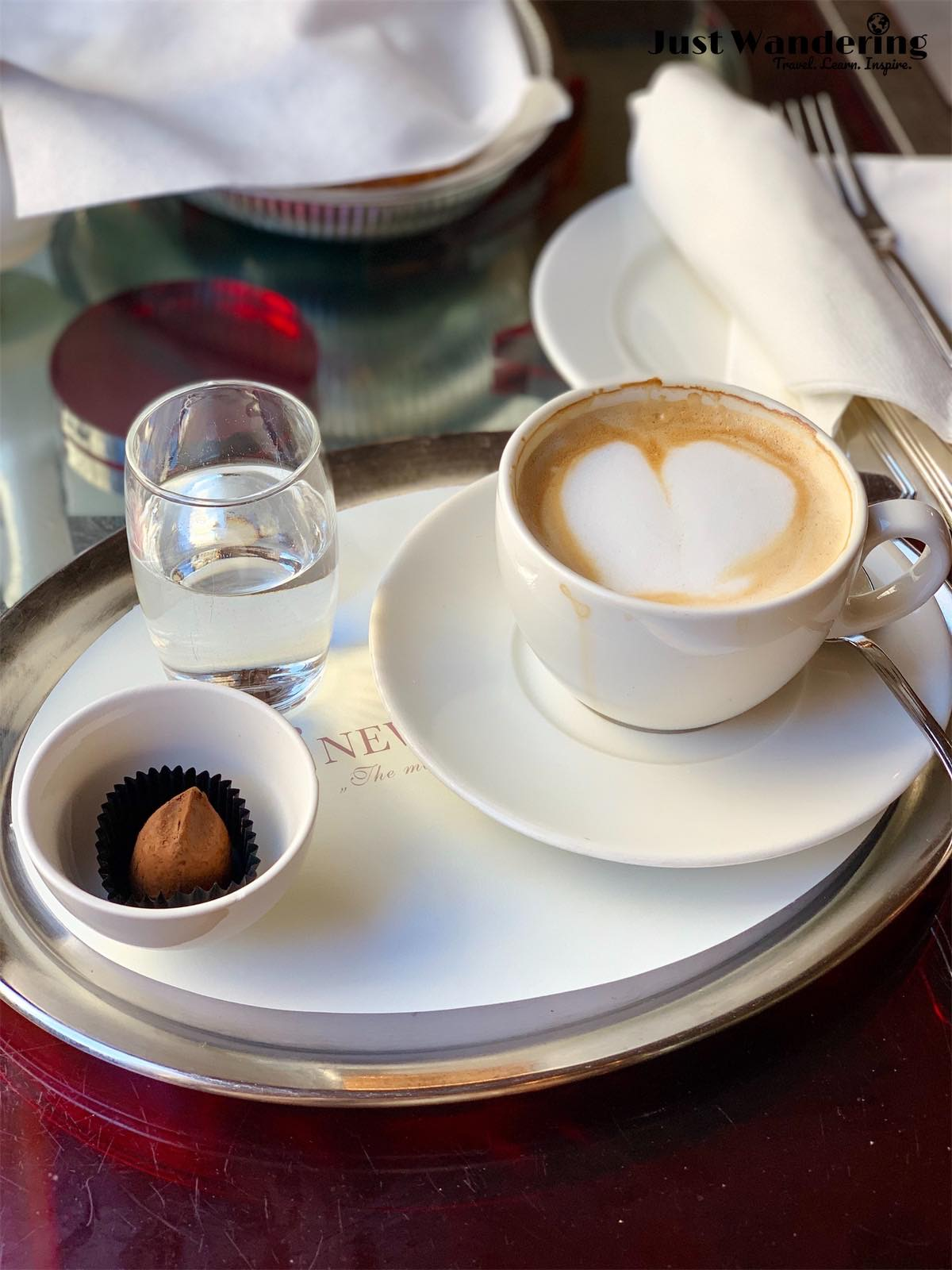- I sampled a selection of items from the breakfast menu. Left: cappuccino, served with a glass of water and a truffle.
