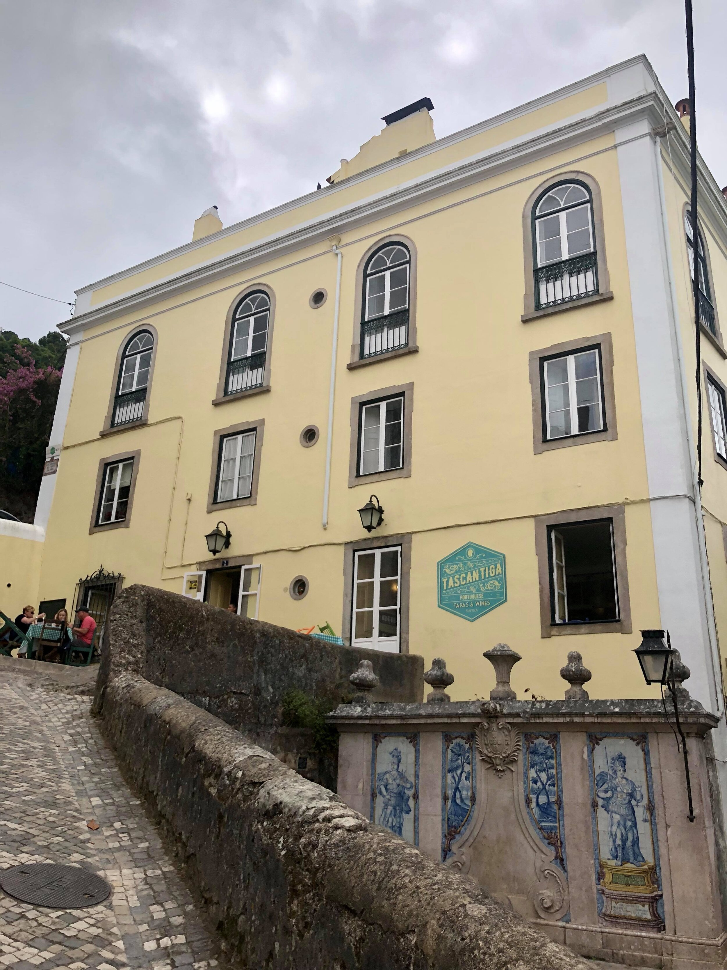 - In the actual town of Sintra, amid cobblestone streets and twisting alleyways, and while looking for a place to eat, we came upon Tascantina. Ok, I'll admit it - we found the restaurant looking at reviews online - this one had essentially 5 star reviews from thousands of people, so it must've been worth a visit (right?)And indeed, popular opinion did not disappoint (as we all know, sometimes it does), Tascantina is indeed a great place to stop by for a bite to eat in the old town of Sintra.