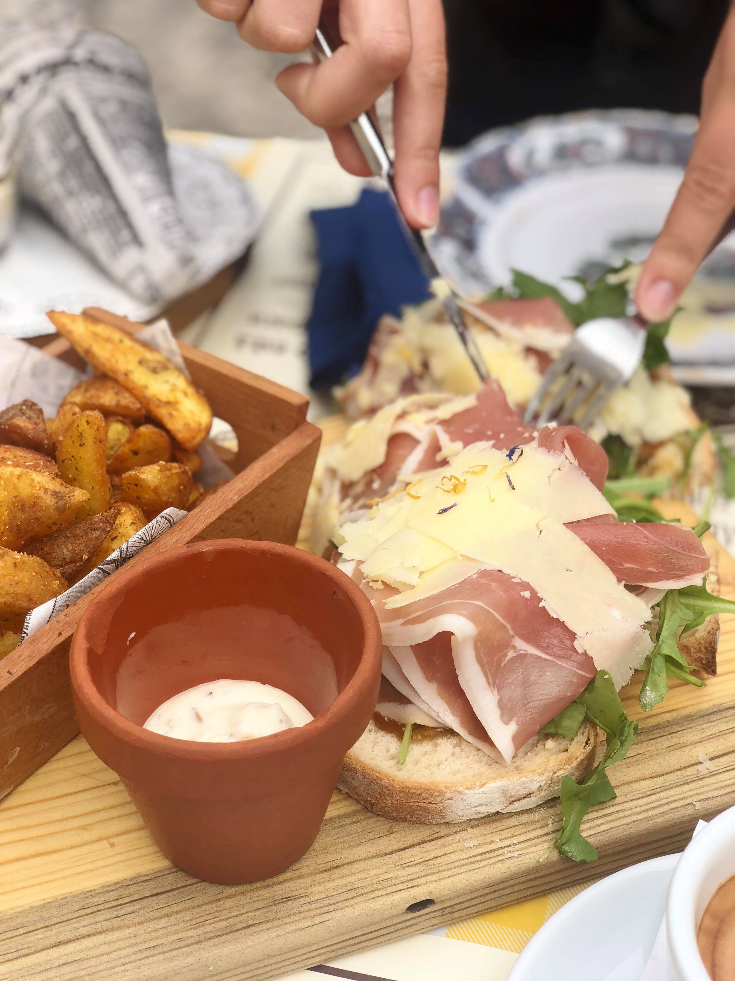 - Finally, a classic ham and cheese (really prosciutto and Parmesan shavings) on an open face sandwich, with a delightful side of 'batatas gomo' or seasoned potato wedges.P.S. Prefer fries instead? Ask for 'batatas palito,' literally potato sticks, to get 'em served the french way.