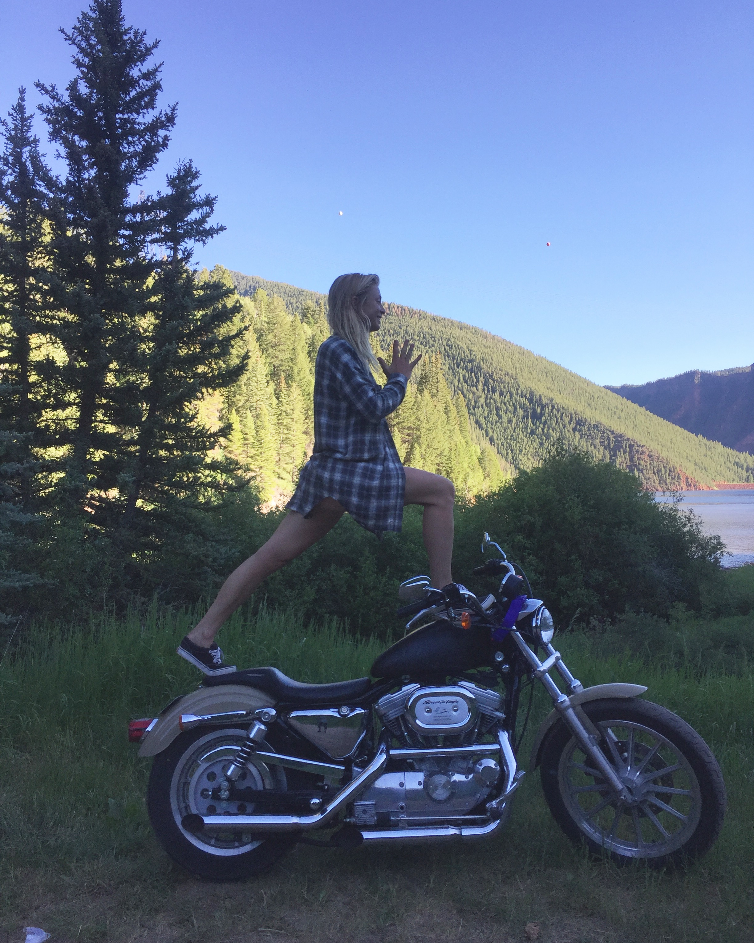 Author, Eliza Demarest practicing yoga-cycle at Ruedi Reservoir.